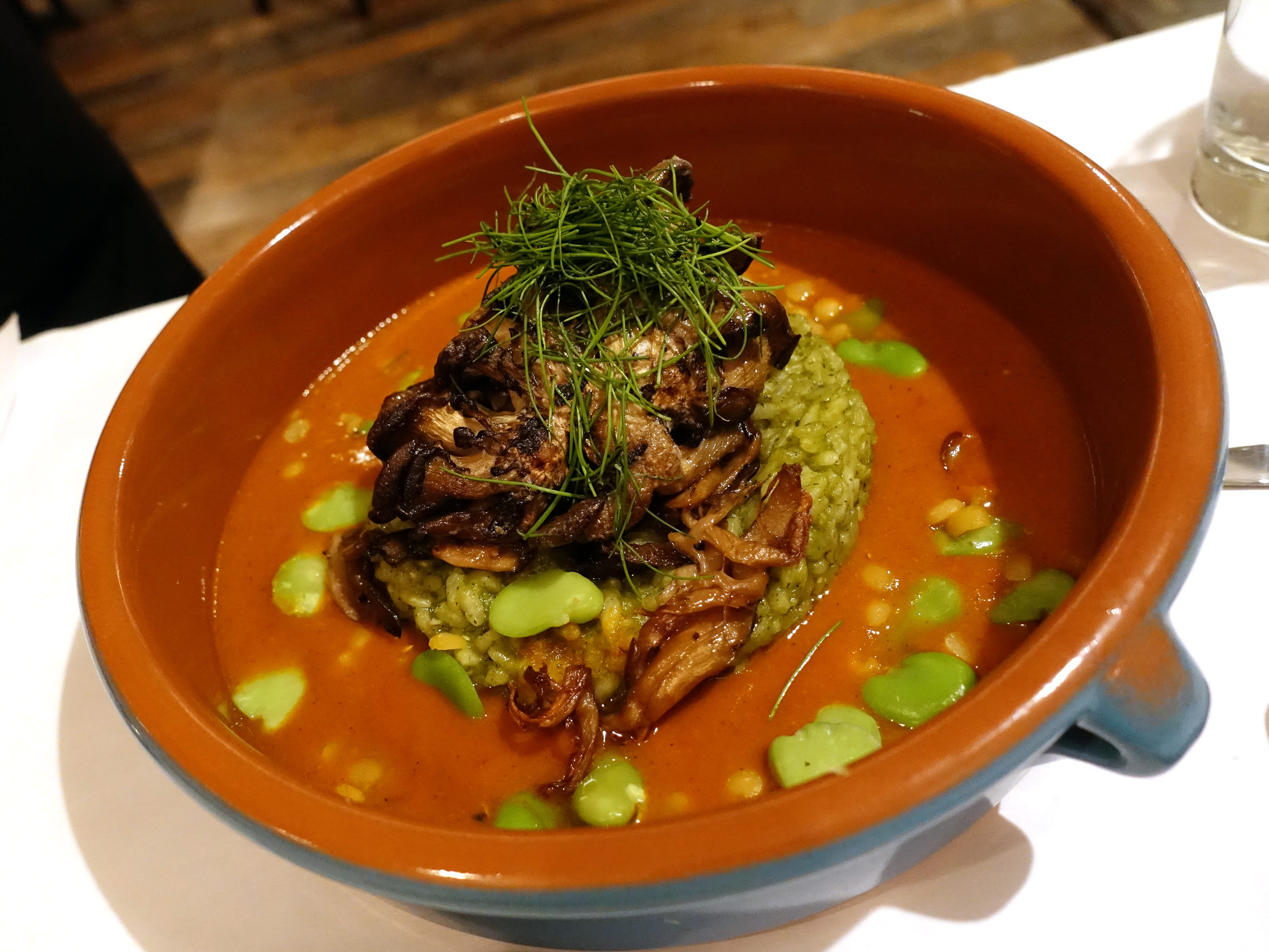 Smoked mushroom cazuela with arroz verde, split peas, fava beans and mole amarillo at Casa Terra in Glendale.