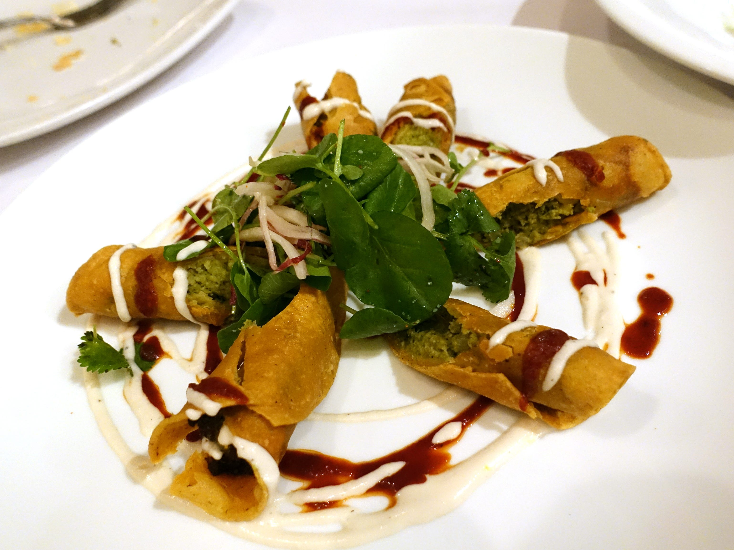 Tempe chorizo verde flautas with Castelvetrano olives, cascabel harissa and crema at Casa Terra in Glendale.