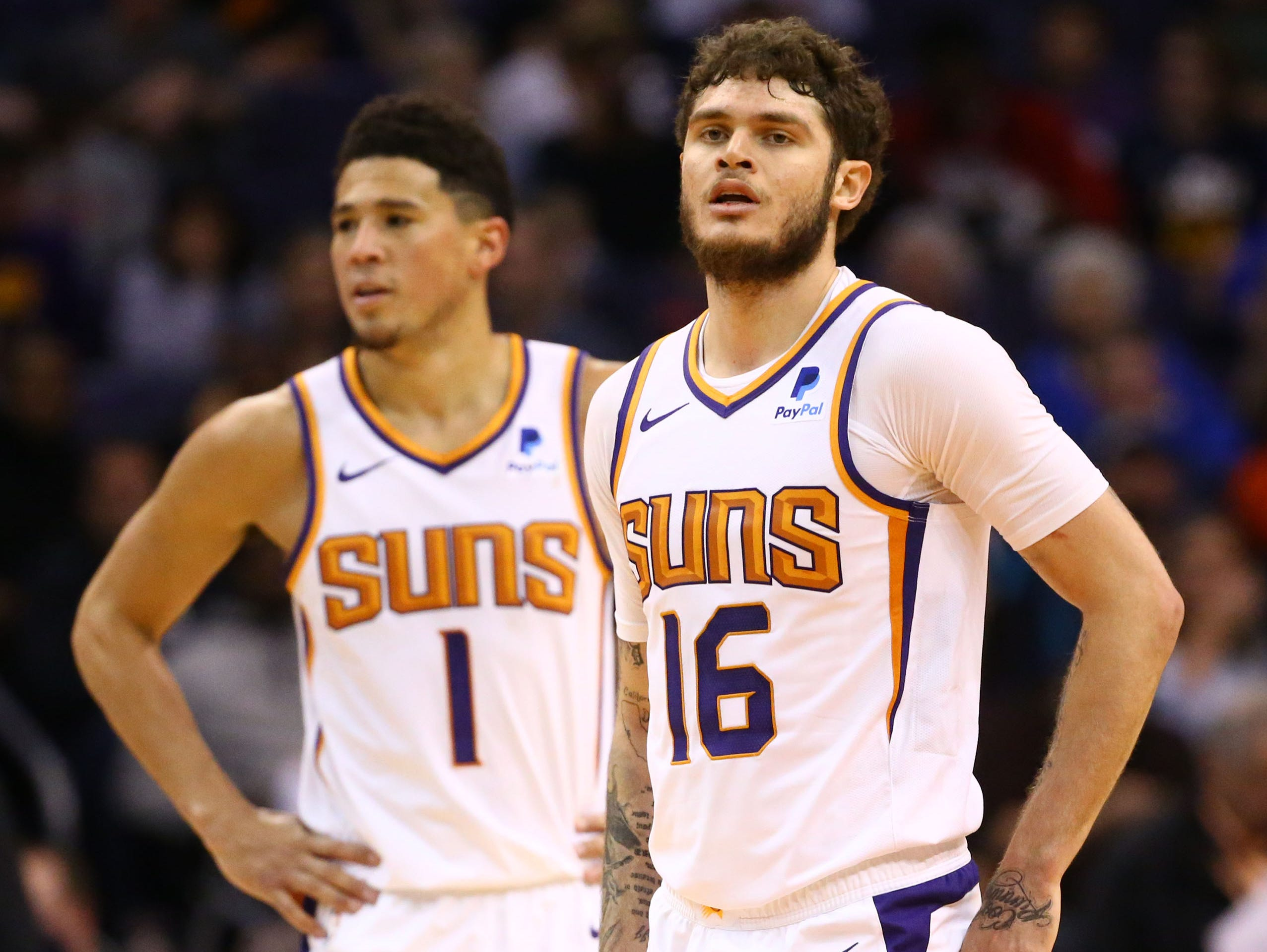 Phoenix Suns guard Devin Booker (1) and Phoenix Suns guard Tyler Johnson (16) against the Utah Jazz in the second half on Mar. 13, 2019 at Talking Stick Resort Arena in Phoenix, Ariz.