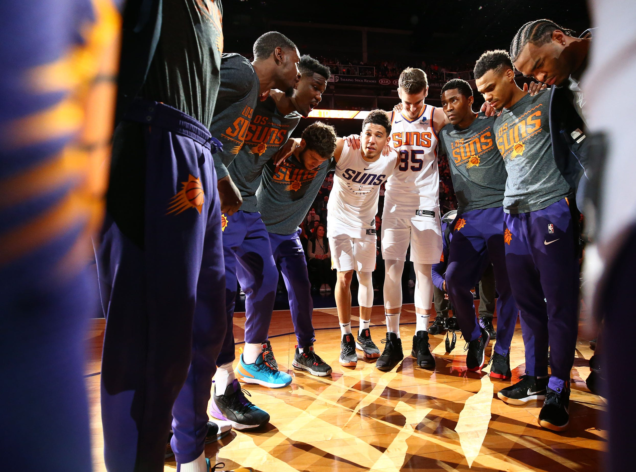 Phoenix Suns guard Devin Booker (1) huddles with the team before playing the Utah Jazz on Mar. 13, 2019 at Talking Stick Resort Arena in Phoenix, Ariz.