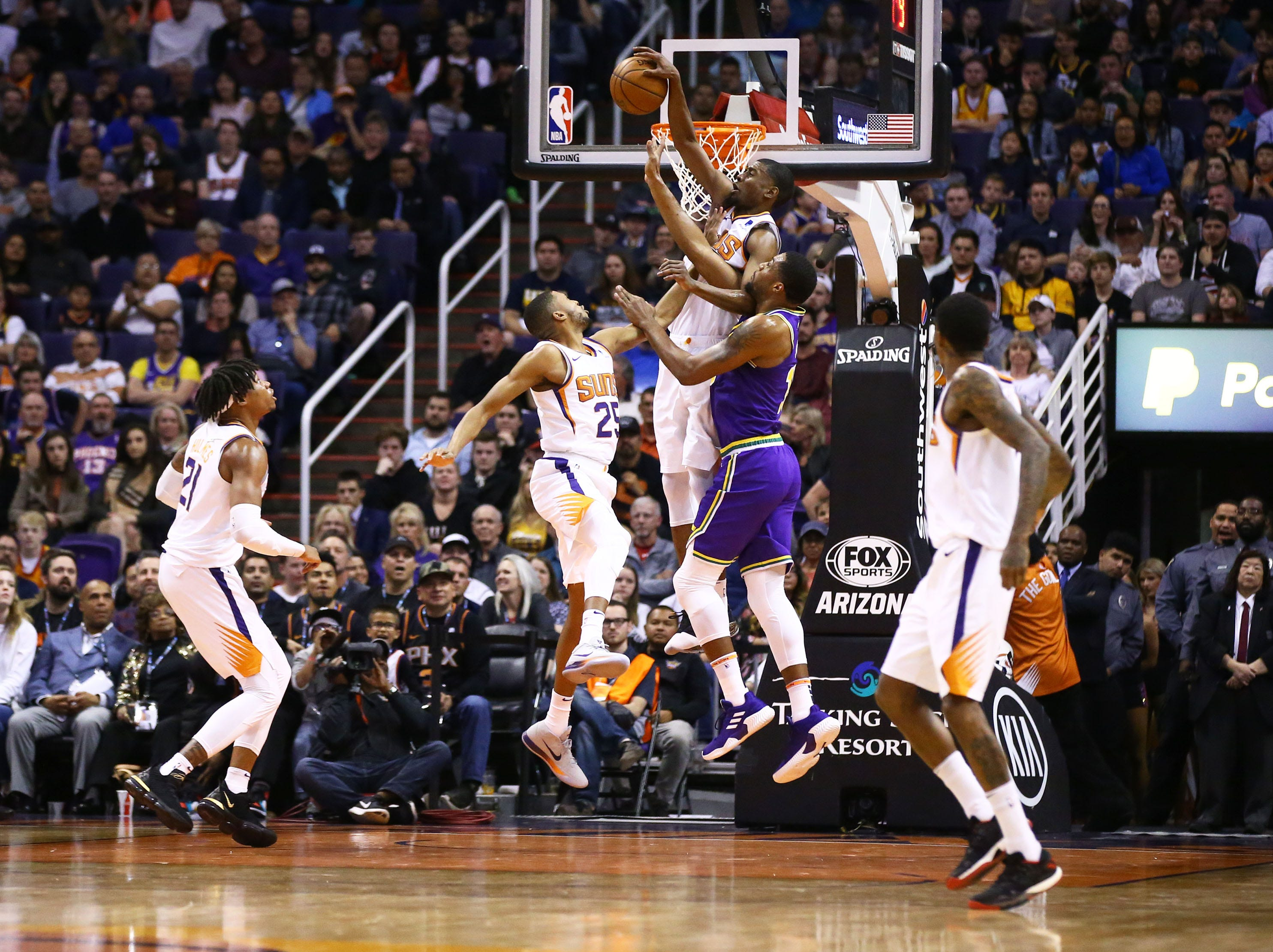 Phoenix Suns forward Josh Jackson (20) rebounds the ball against the Utah Jazz in the second half on Mar. 13, 2019 at Talking Stick Resort Arena in Phoenix, Ariz.