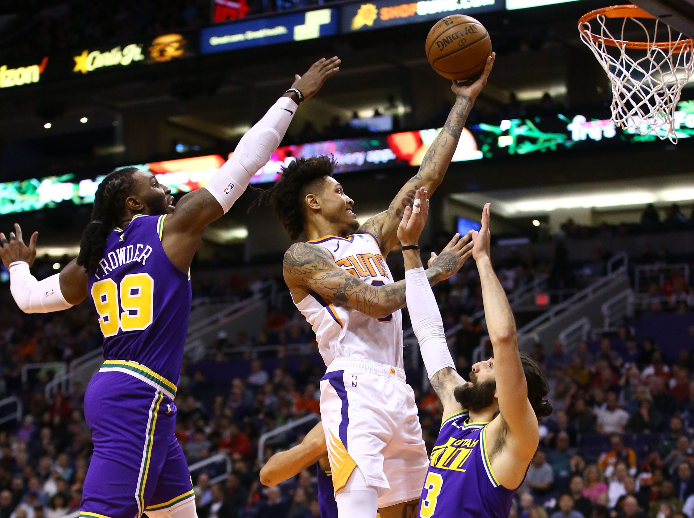 Phoenix Suns forward Kelly Oubre Jr. (3) drives to the basket over Utah Jazz guard Ricky Rubio (3) and forward Jae Crowder (99) in the first half on Mar. 13, 2019 at Talking Stick Resort Arena in Phoenix, Ariz.