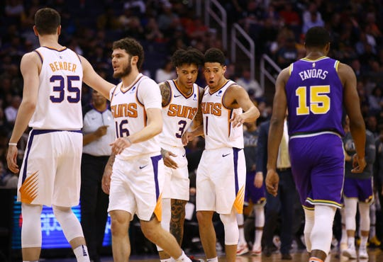 Phoenix Suns forward Kelly Oubre Jr. (3) and guard Devin Booker (1) talk during a time out against the Utah Jazz in the second half on Mar. 13, 2019 at Talking Stick Resort Arena in Phoenix, Ariz.