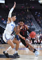 Mar 13, 2019; Las Vegas, NV, United States; Stanford Cardinal guard Bryce Wills (2) dribbles against UCLA Bruins guard Jules Bernard (3) during the first half of a Pac-12 conference tournament game at T-Mobile Arena. Mandatory Credit: Stephen R. Sylvanie-USA TODAY Sports