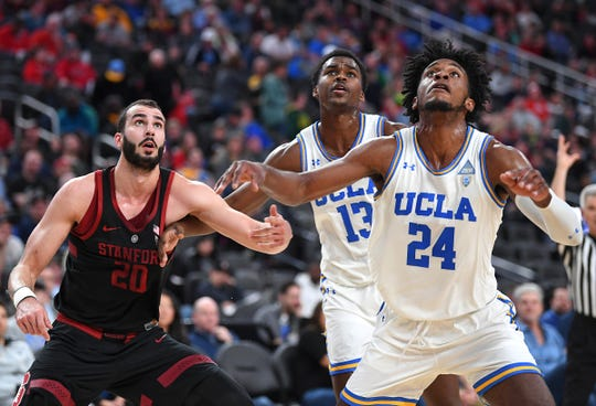 Mar 13, 2019; Las Vegas, NV, United States; Stanford Cardinal center Josh Sharma (20) UCLA Bruins guard Kris Wilkes (13) and UCLA Bruins guard Jalen Hill (24) watch a free throw attempt fall during the first half of a Pac-12 conference tournament game at T-Mobile Arena. Mandatory Credit: Stephen R. Sylvanie-USA TODAY Sports