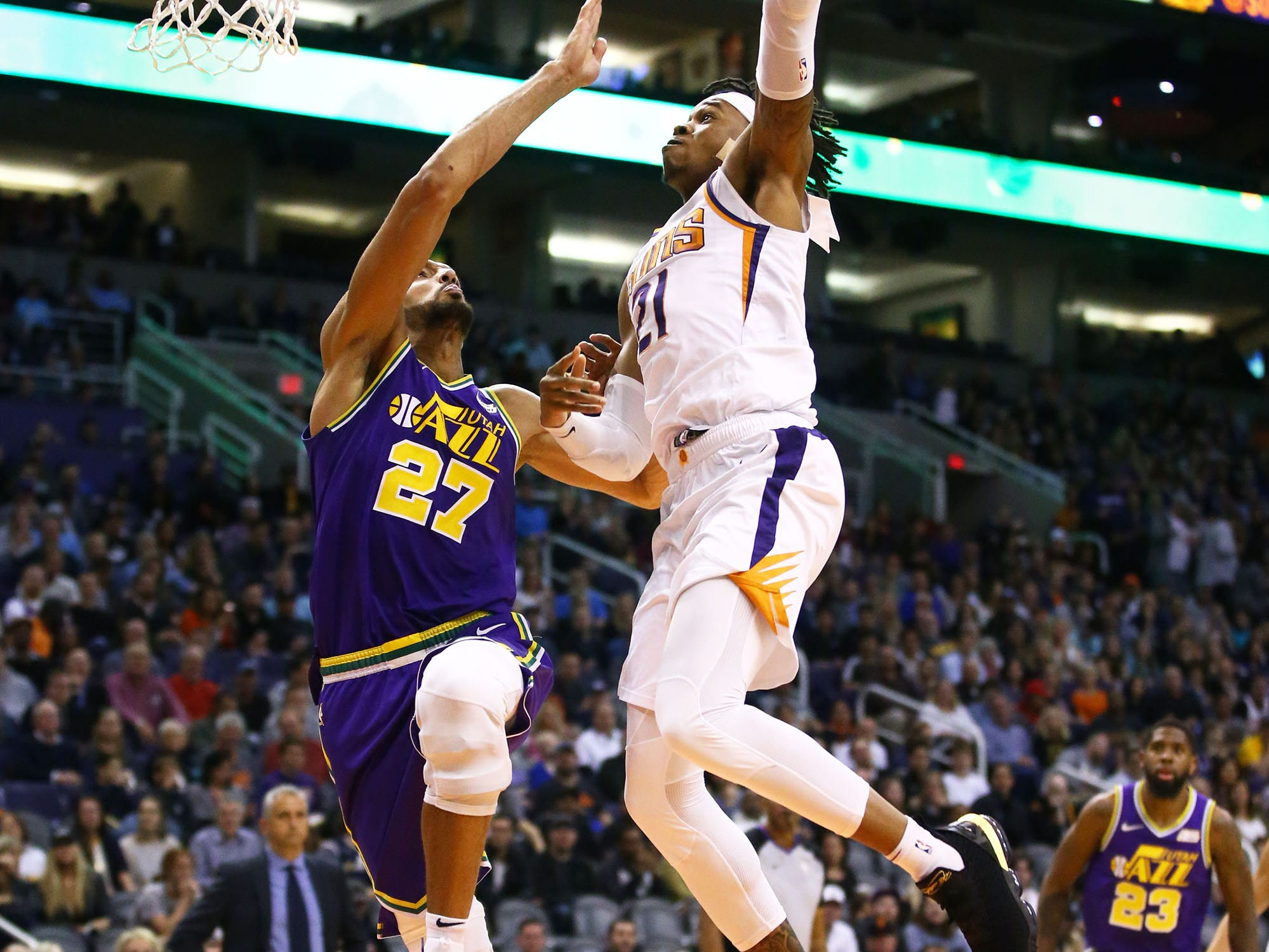 Phoenix Suns forward Richaun Holmes (21) dunks the ball over Utah Jazz center Rudy Gobert (27) in the second half on Mar. 13, 2019 at Talking Stick Resort Arena in Phoenix, Ariz.