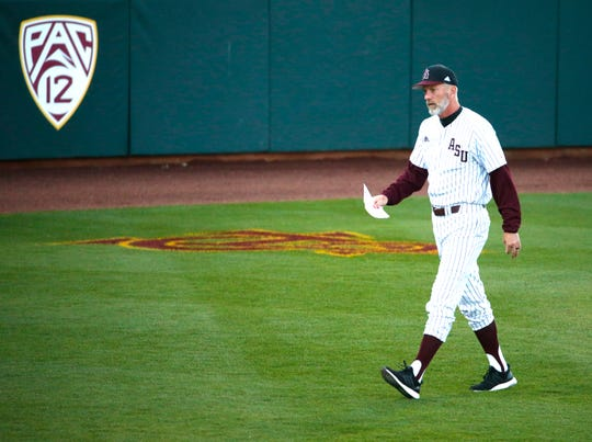 ASU head baseball coach Tracy Smith walks back to the dugout before a baseball game against New Mexico at Phoenix Municipal Stadium on March 13, 2019.