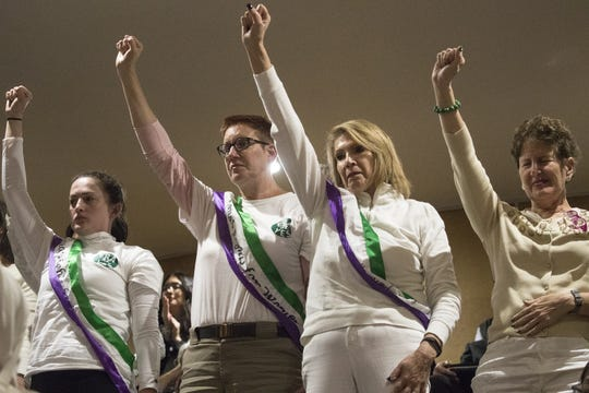 From left: Kim Mundis, Judith Donvers, Civia Tamarkin and Sandra Bondy show support for the Equal Rights Amendment from the Senate gallery, March 13, 2019, at the Arizona Capitol.
