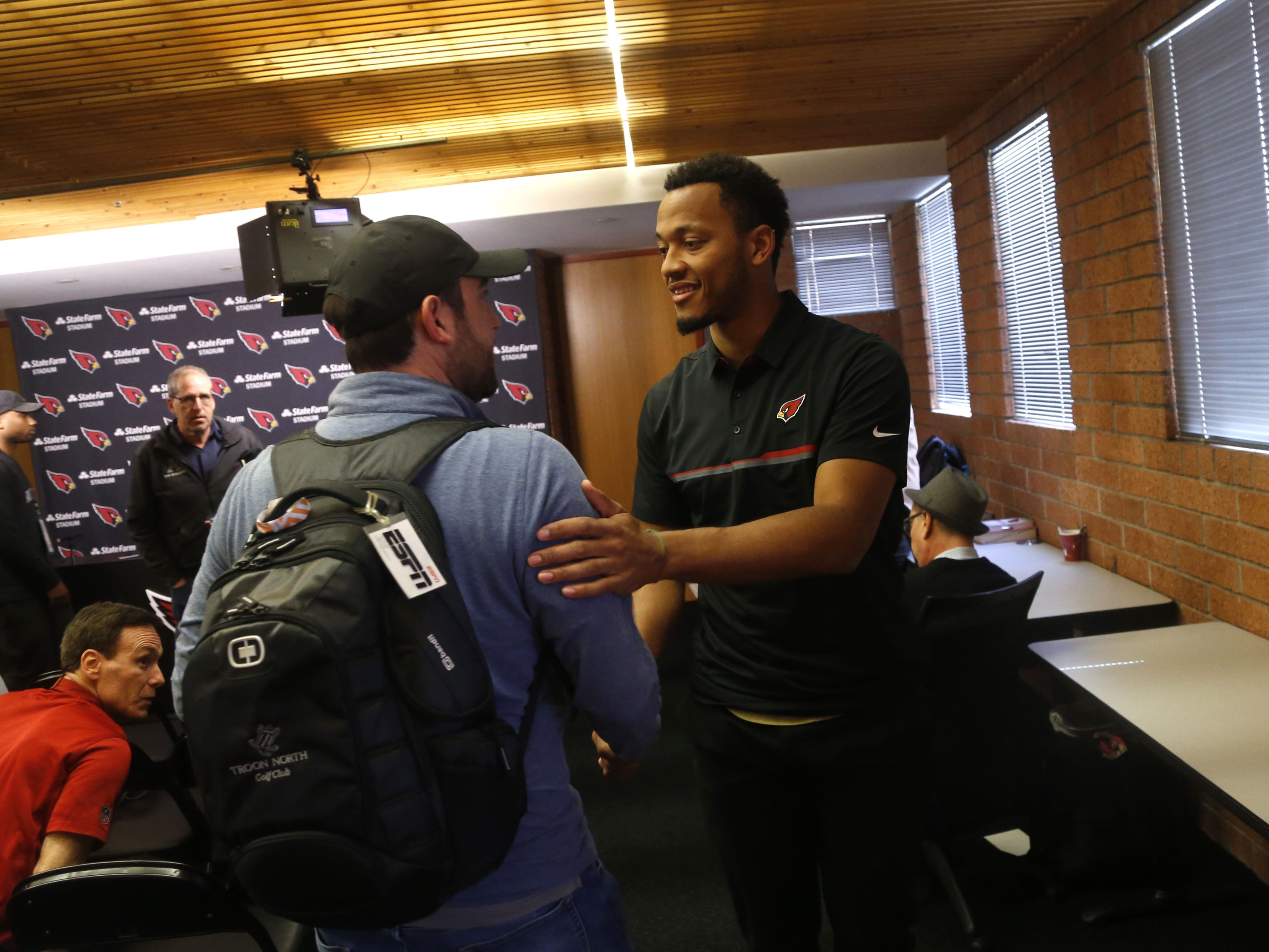 Brett Hundley shakes the hand of ESPN's Josh Weinfuss after his introductory press conference at the Arizona Cardinals Training Facility in Tempe, Ariz. on March 14, 2019.