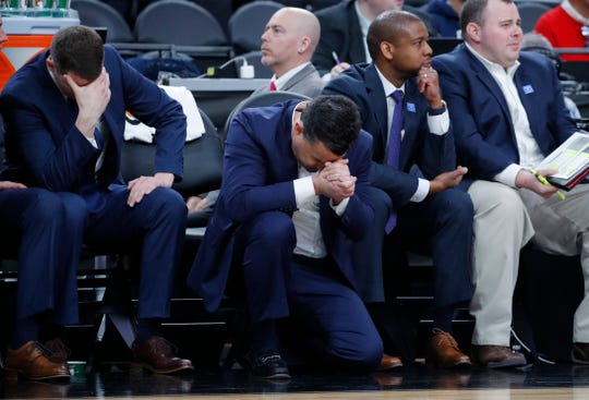Arizona's head coach Sean Miller, center, reacts after a play against Southern California during the second half of an NCAA college basketball game in the first round of the Pac-12 men's tournament Wednesday, March 13, 2019, in Las Vegas.