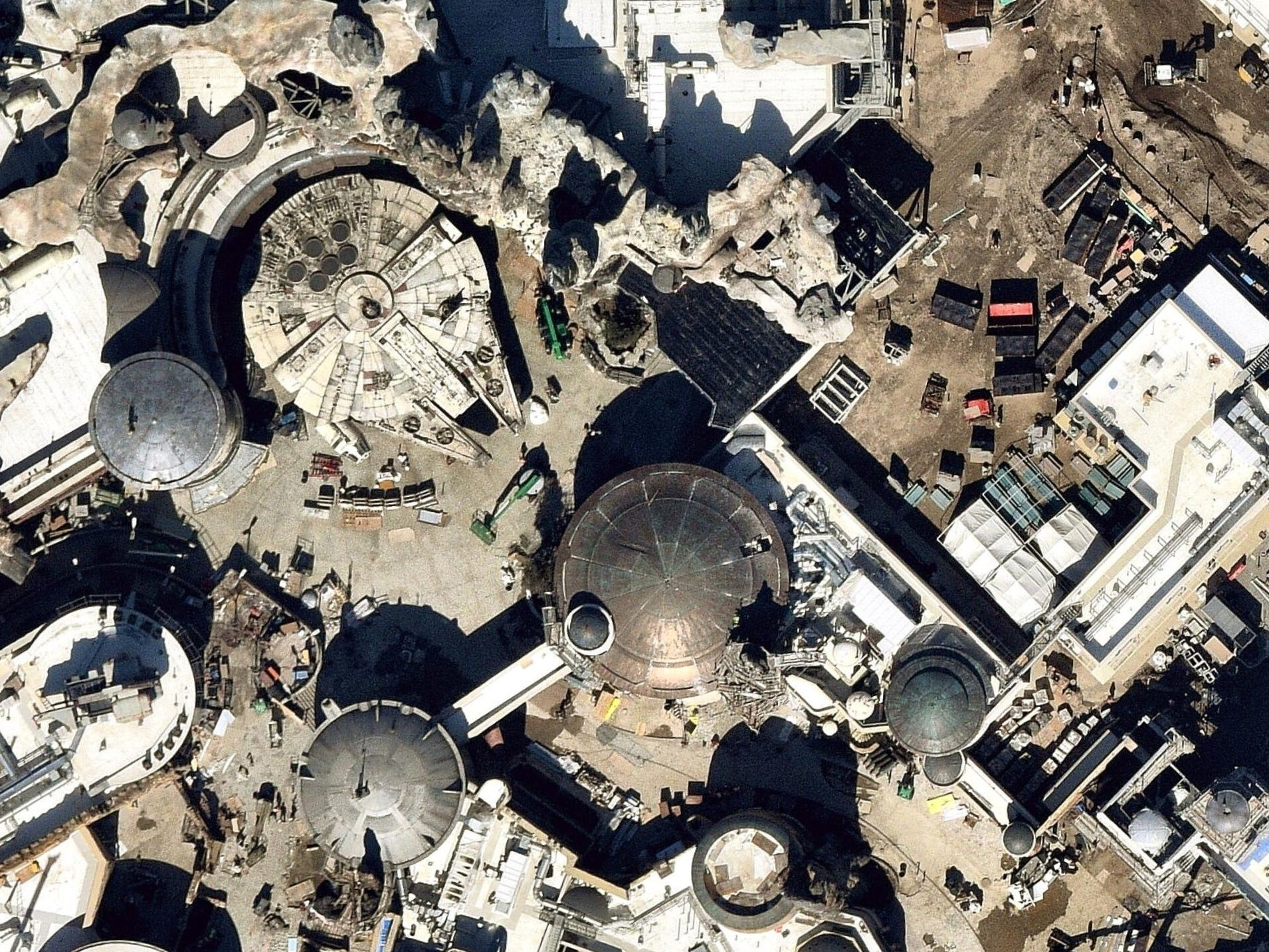 The Millennium Falcon, upper left, is parked among the marketplace of the Black Spire Outpost in Disneyland's Star Wars: Galaxy's Edge. The path leading down from the ship takes guests through shops and restaurants. The satellite image from Nearmap was taken in February 2019.