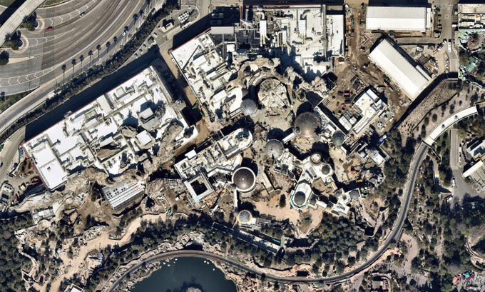Star Wars: Galaxy's Edge at Disneyland is seen from space in this image taken by Nearmap in February 2019. Note the most iconic ship in the galaxy near the center: the Millennium Falcon.