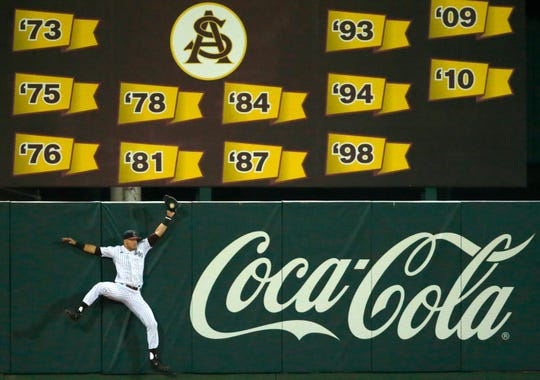ASU center fielder Hunter Bishop (4) catches the a fly ball during a baseball game against New Mexico at Phoenix Municipal Stadium on March 13, 2019.