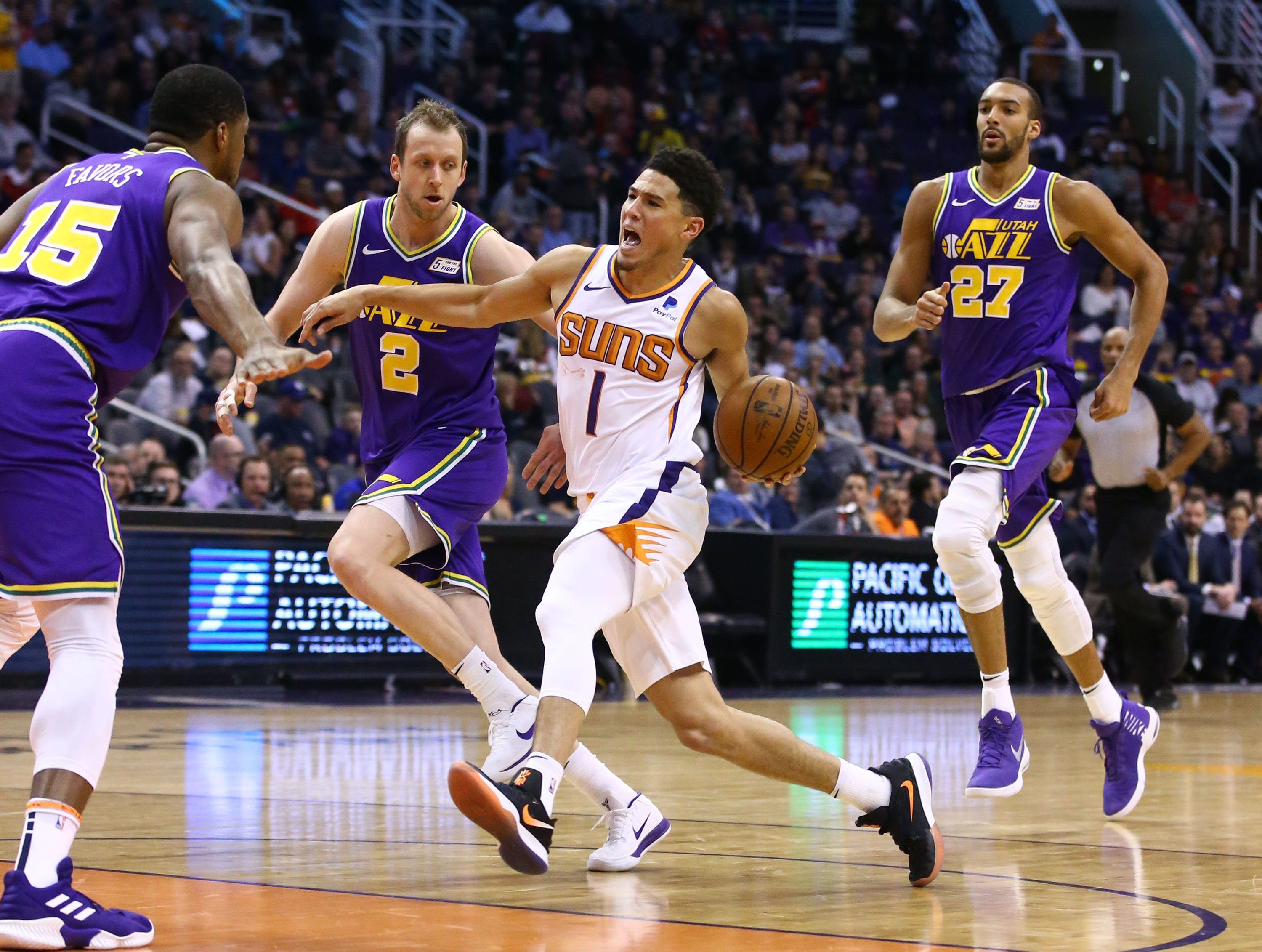 Phoenix Suns guard Devin Booker (1) drives the ball into the Utah Jazz defense in the second half on Mar. 13, 2019 at Talking Stick Resort Arena in Phoenix, Ariz.