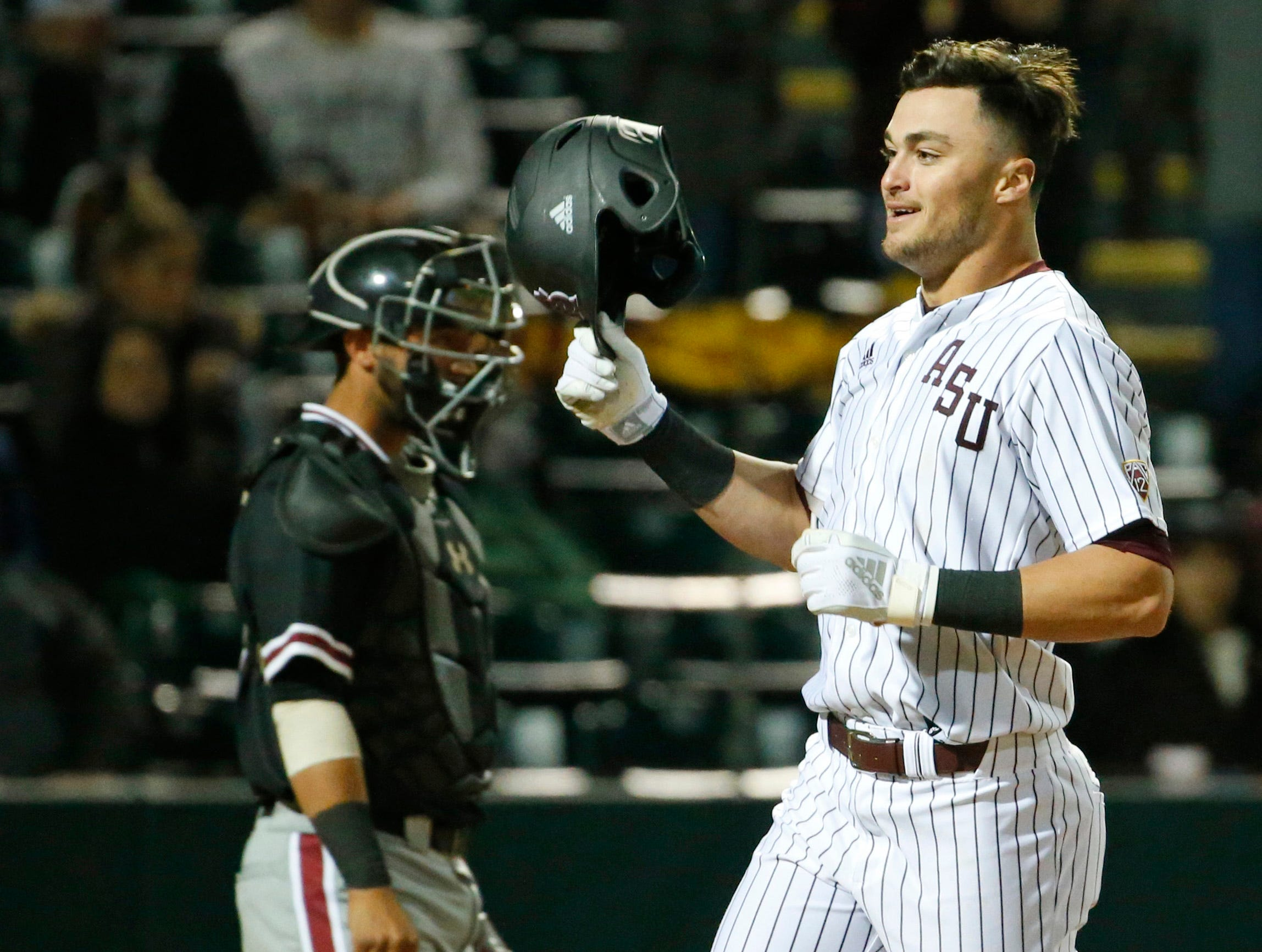 ASU Hunter Bishop (4) celebrates after hitting a home run during a baseball game against New Mexico at Phoenix Municipal Stadium on March 13, 2019.