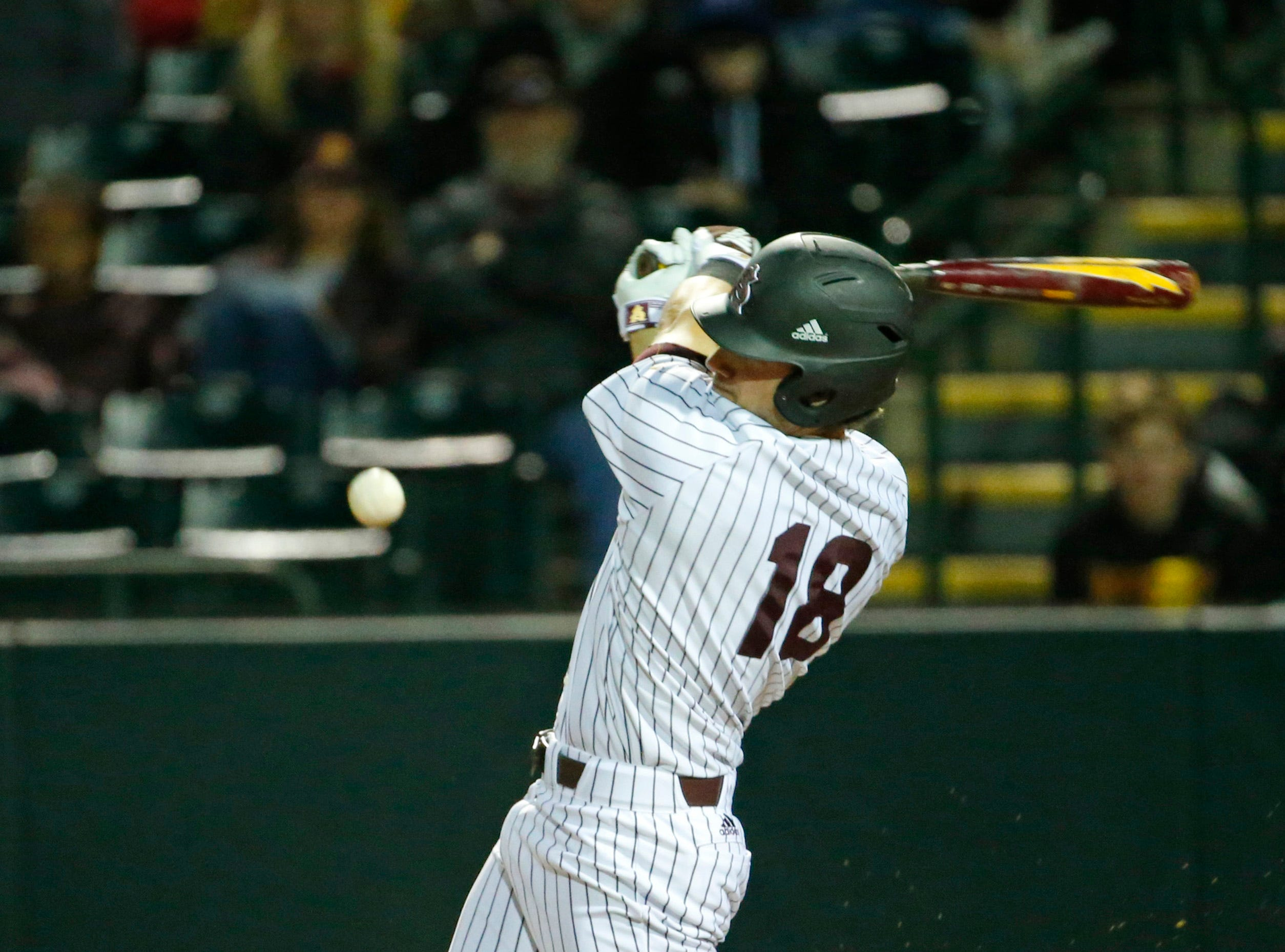 ASU left fielder Trevor Hauver (18) at bat during a baseball game against New Mexico at Phoenix Municipal Stadium on March 13, 2019.