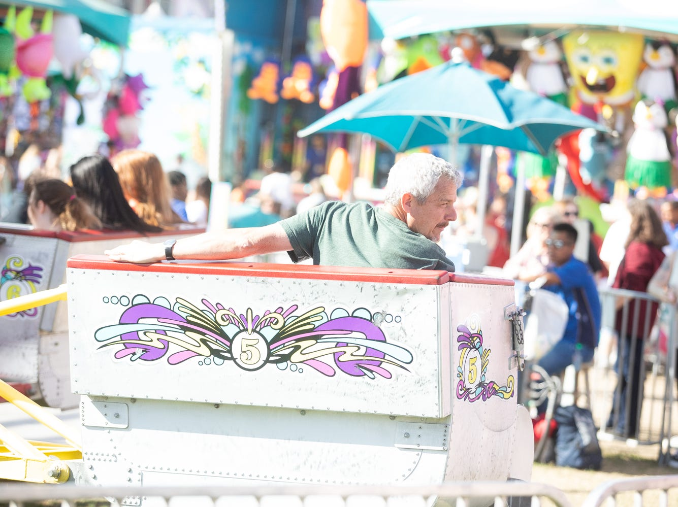 Even the adults enjoyed the rides at the Chandler Ostrich Festival on Sunday, March. 10, 2019.