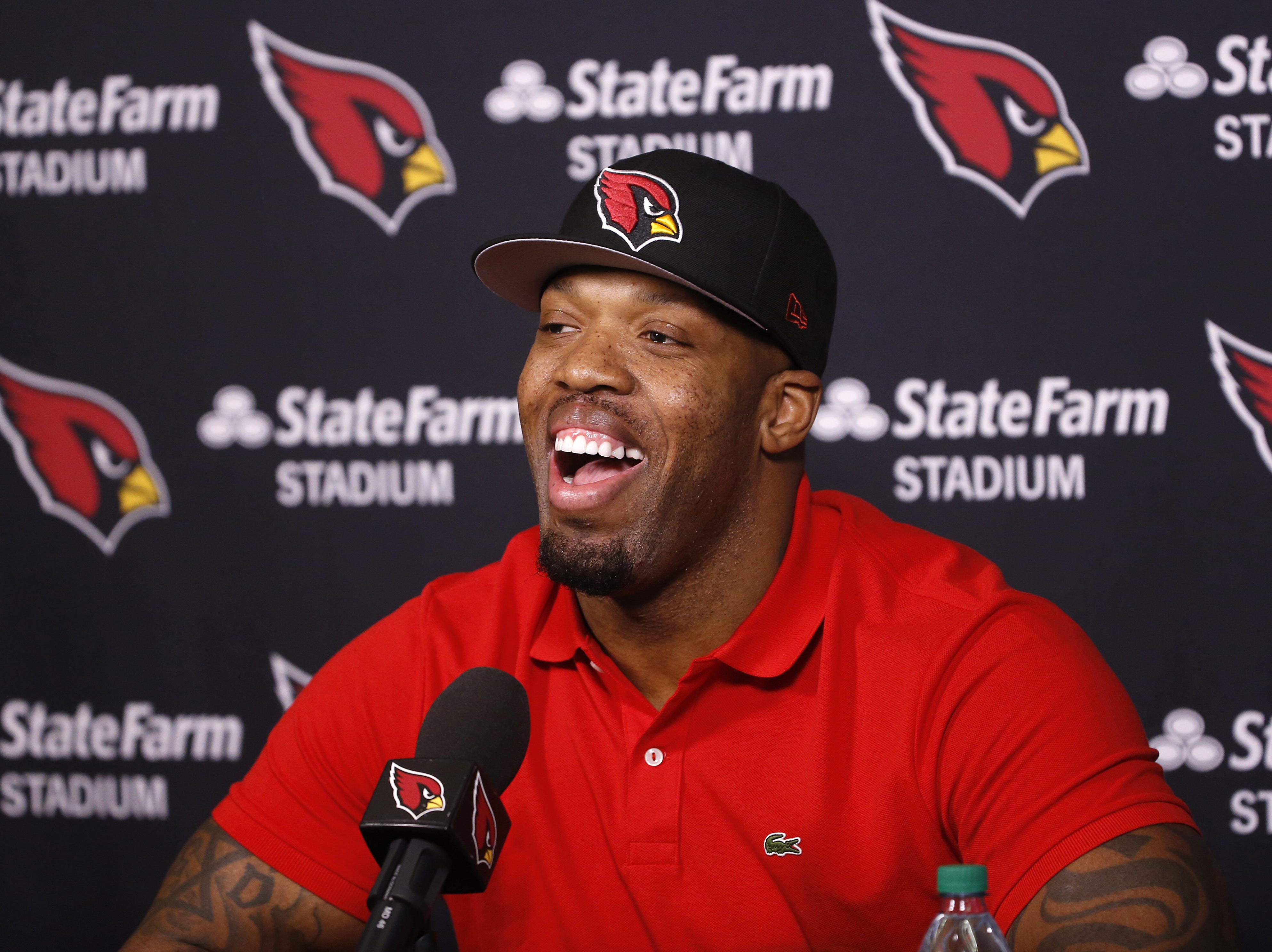 Terrell Suggs laughs while answering questions during his introductory press conference at the Arizona Cardinals Training Facility in Tempe, Ariz. on March 14, 2019.