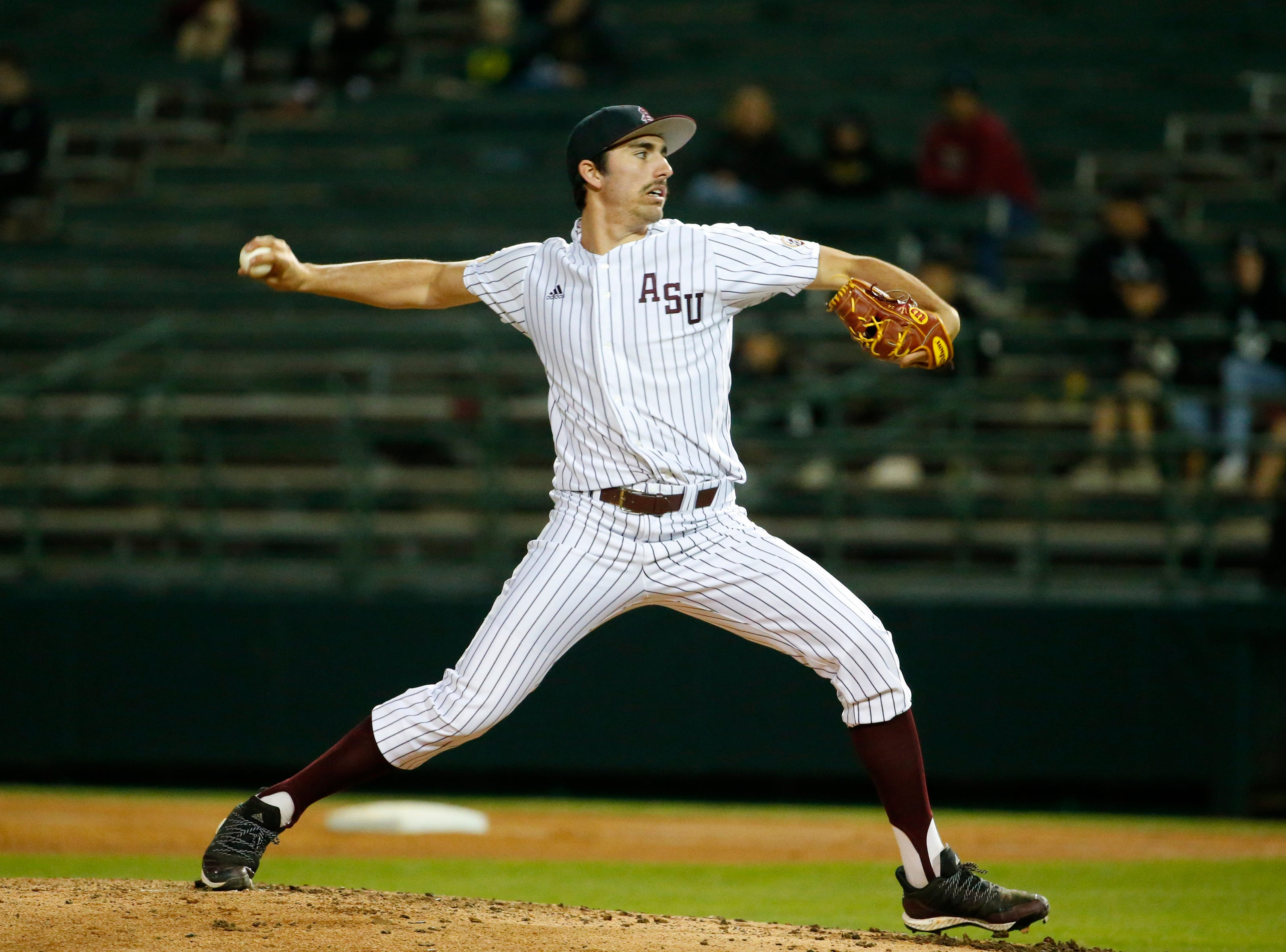 ASU RHP Blake Burzell (24) throws during a baseball game against New Mexico at Phoenix Municipal Stadium on March 13, 2019.