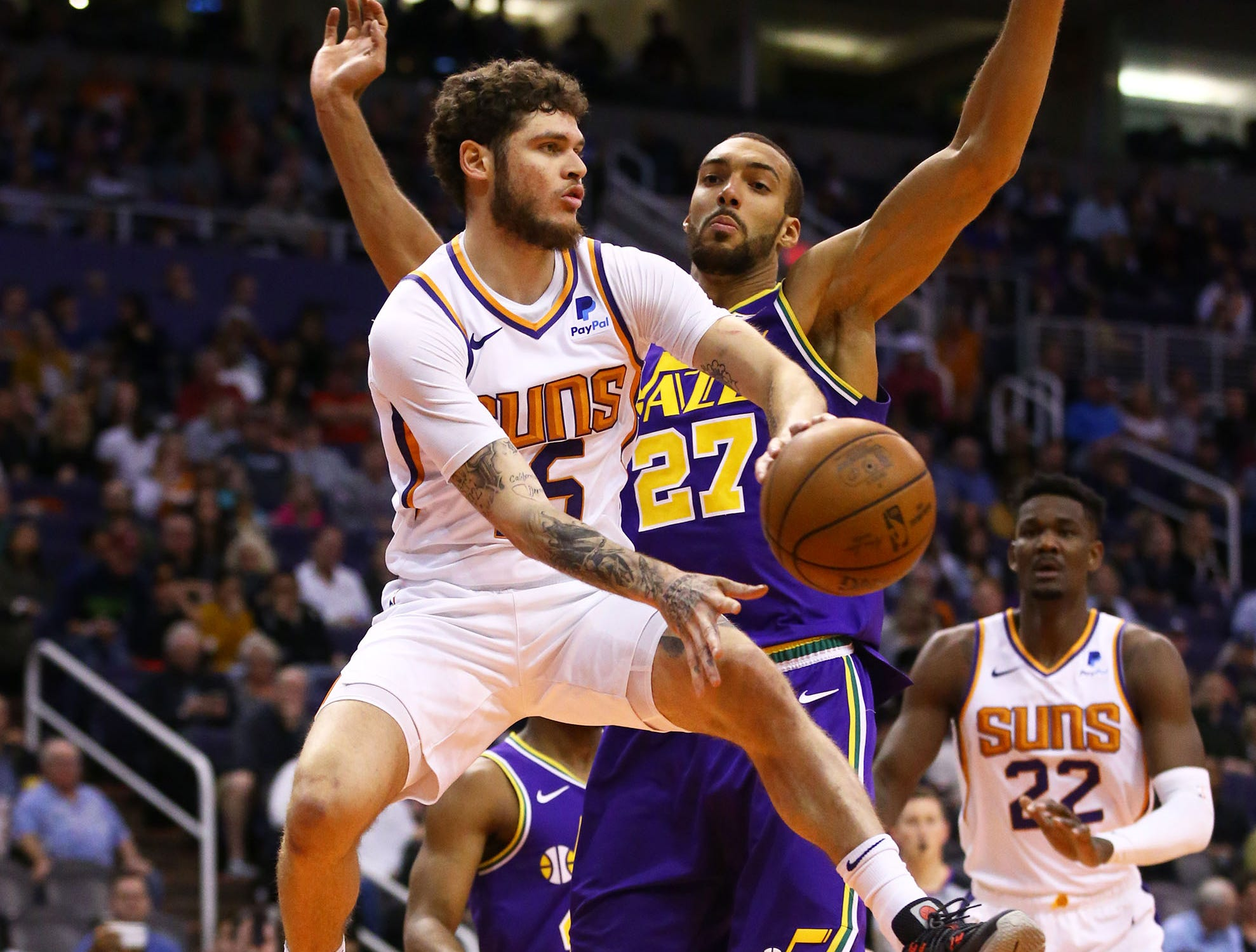 Phoenix Suns guard Tyler Johnson (16) passes the ball against Utah Jazz center Rudy Gobert (27) in the second half on Mar. 13, 2019 at Talking Stick Resort Arena in Phoenix, Ariz.