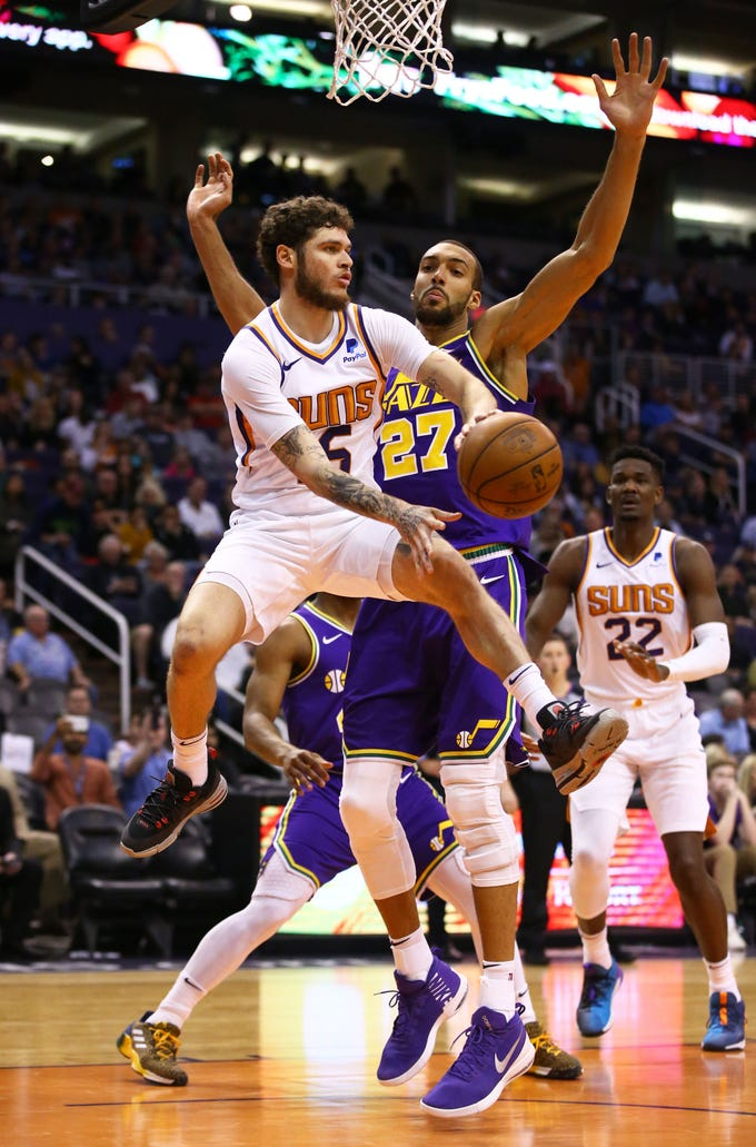Phoenix Suns guard Tyler Johnson (16) passes the ball against Utah Jazz center Rudy Gobert (27) in the second half on Mar. 13, 2019 at Talking Stick Resort Arena in Phoenix, Ariz.
