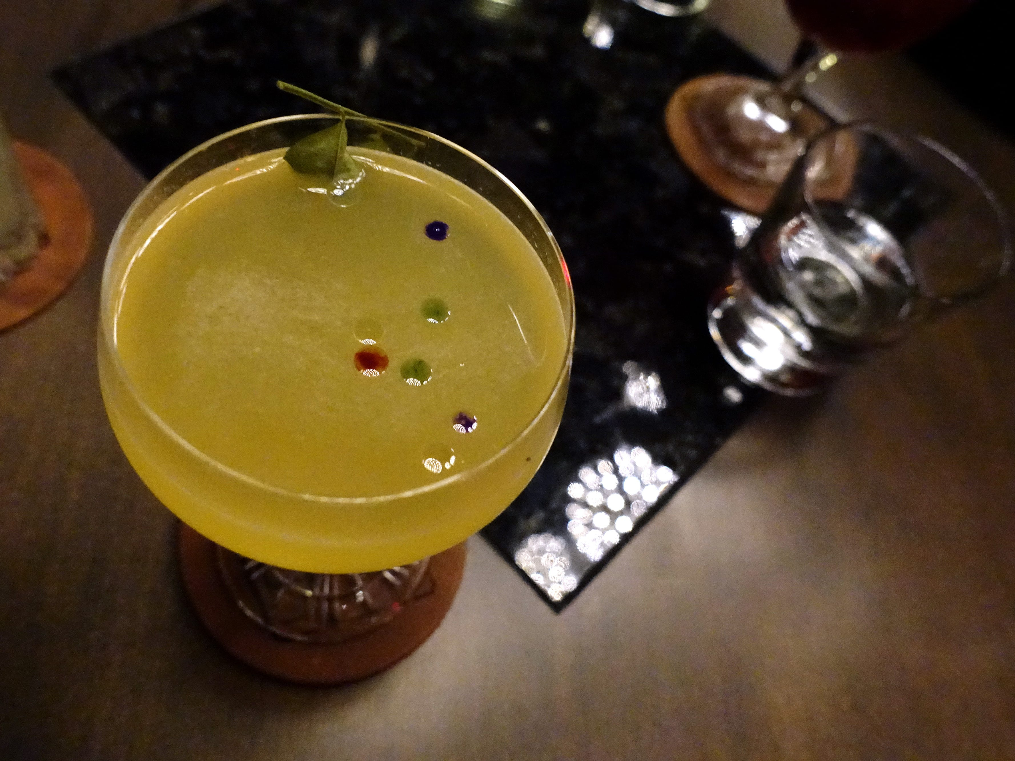 Daiqurry with Blended Island rum, LR curry syrup, fresh lime, Yellow Chartreuse and sichuan pepper oil at Little Rituals in Phoenix.