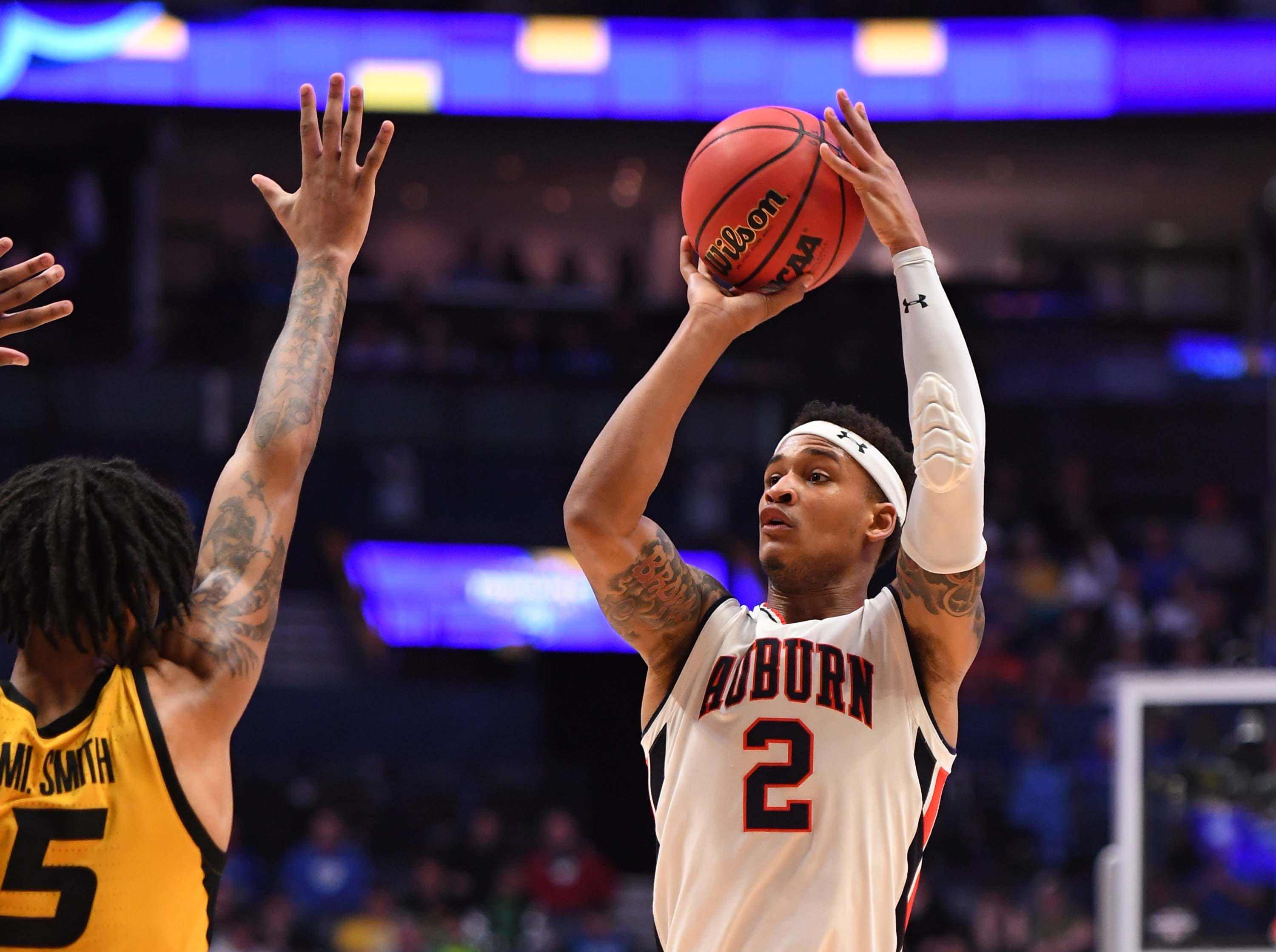Mar 14, 2019; Nashville, TN, USA; Auburn Tigers guard Bryce Brown (2) shoots over Missouri Tigers forward Mitchell Smith (5) during the first half of the SEC conference tournament at Bridgestone Arena. Mandatory Credit: Christopher Hanewinckel-USA TODAY Sports
