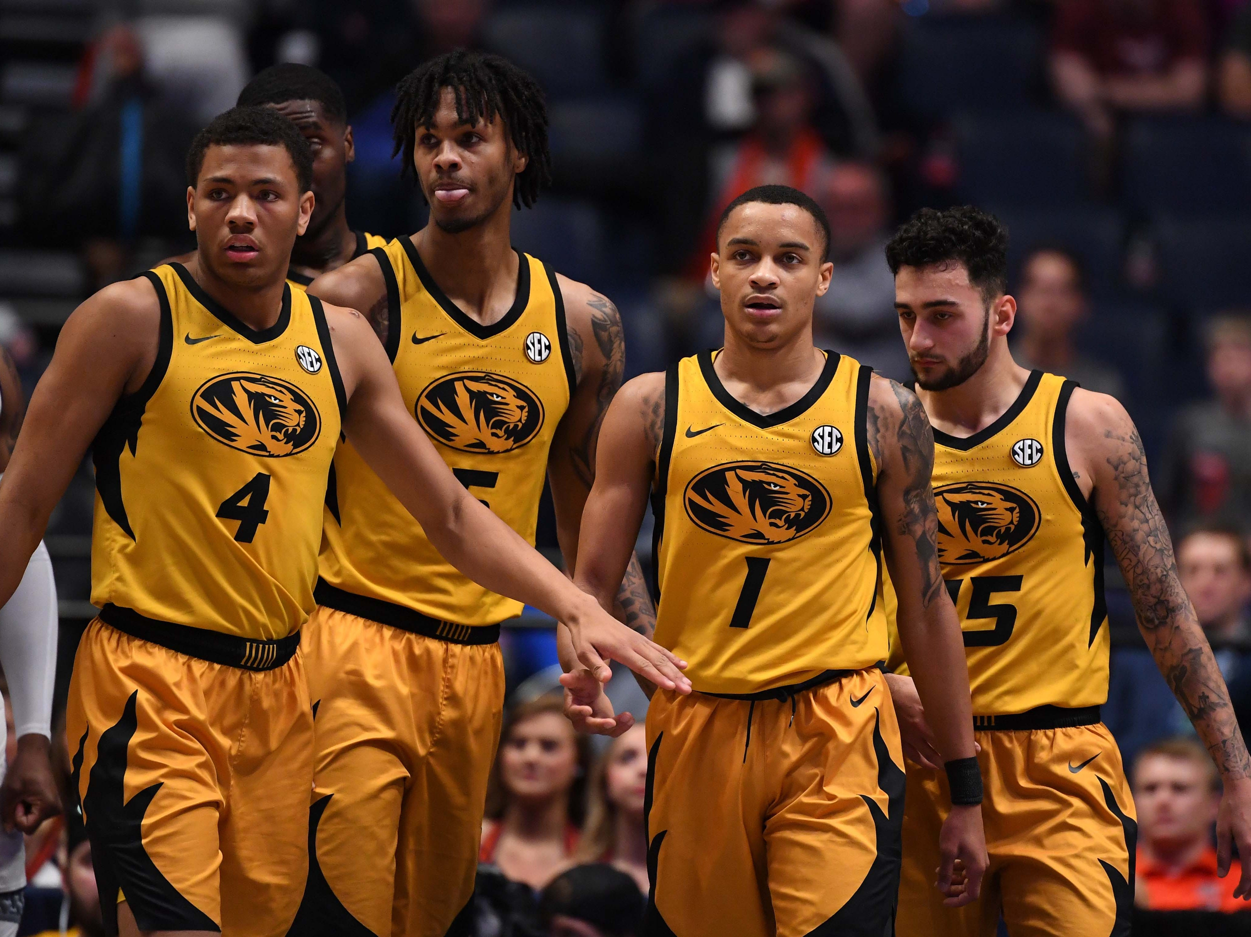 Mar 14, 2019; Nashville, TN, USA; Missouri Tigers guard Xavier Pinson (1) is congratulated by teammates after a play against the Auburn Tigers during the first half of the SEC conference tournament at Bridgestone Arena. Mandatory Credit: Christopher Hanewinckel-USA TODAY Sports