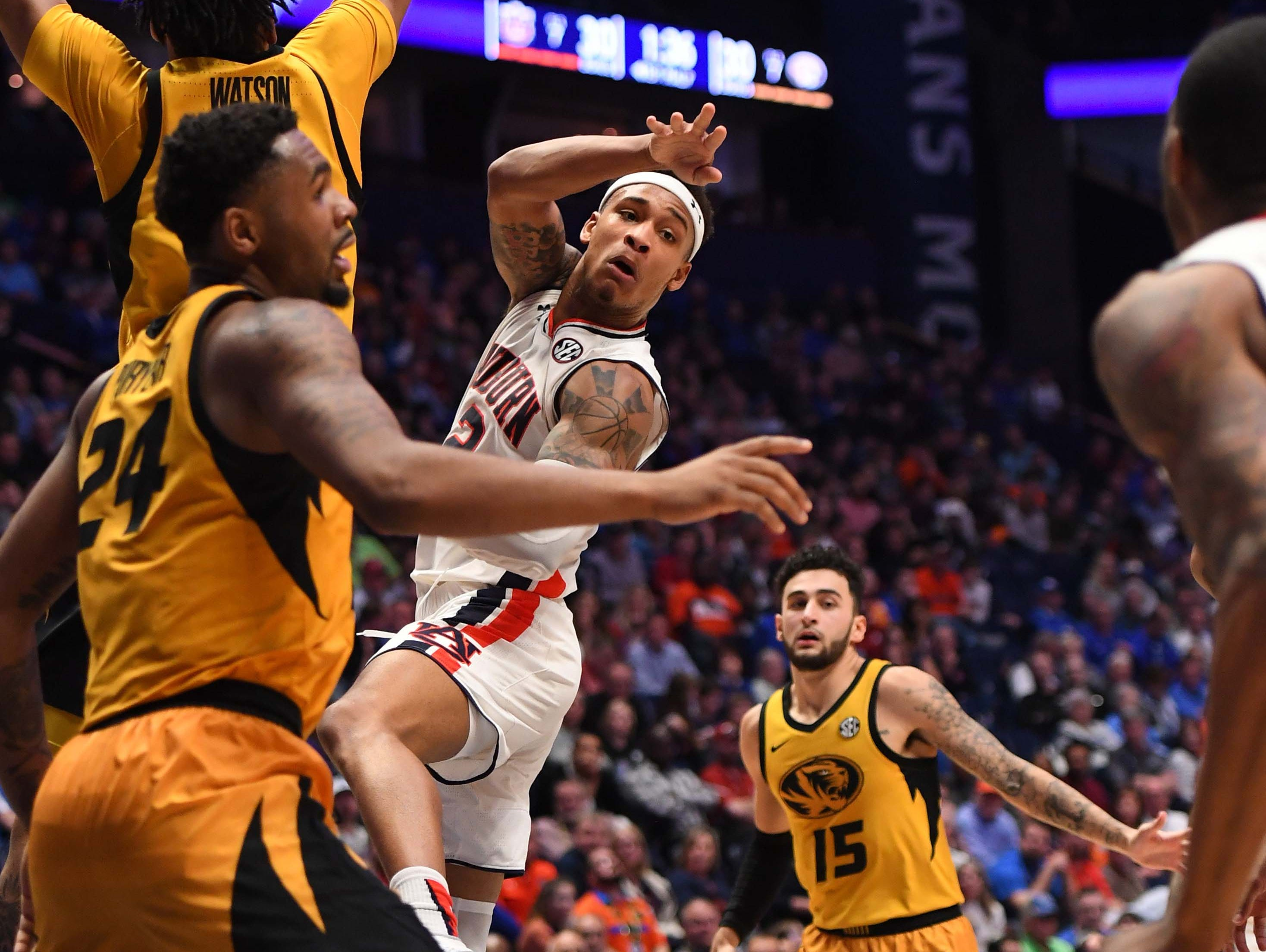 Mar 14, 2019; Nashville, TN, USA; Auburn Tigers guard Bryce Brown (2) passes the ball to the corner on a play against the Missouri Tigers during the first half of the SEC conference tournament at Bridgestone Arena. Mandatory Credit: Christopher Hanewinckel-USA TODAY Sports