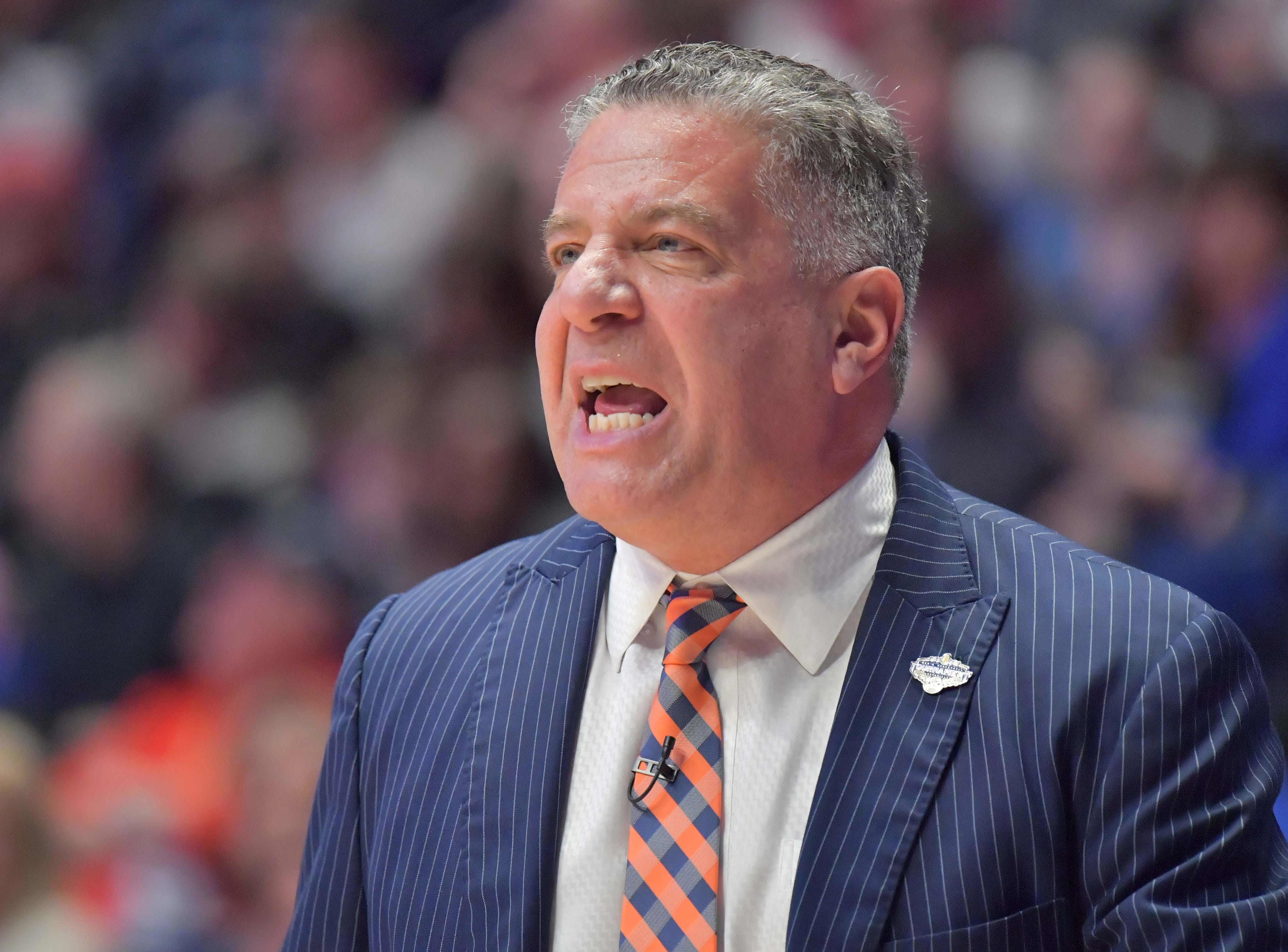 Mar 14, 2019; Nashville, TN, USA; Auburn Tigers head coach Bruce Pearl raects in the first half Auburn Tigers mascot entertains fans in the SEC conference tournament at Bridgestone Arena. Mandatory Credit: Jim Brown-USA TODAY Sports