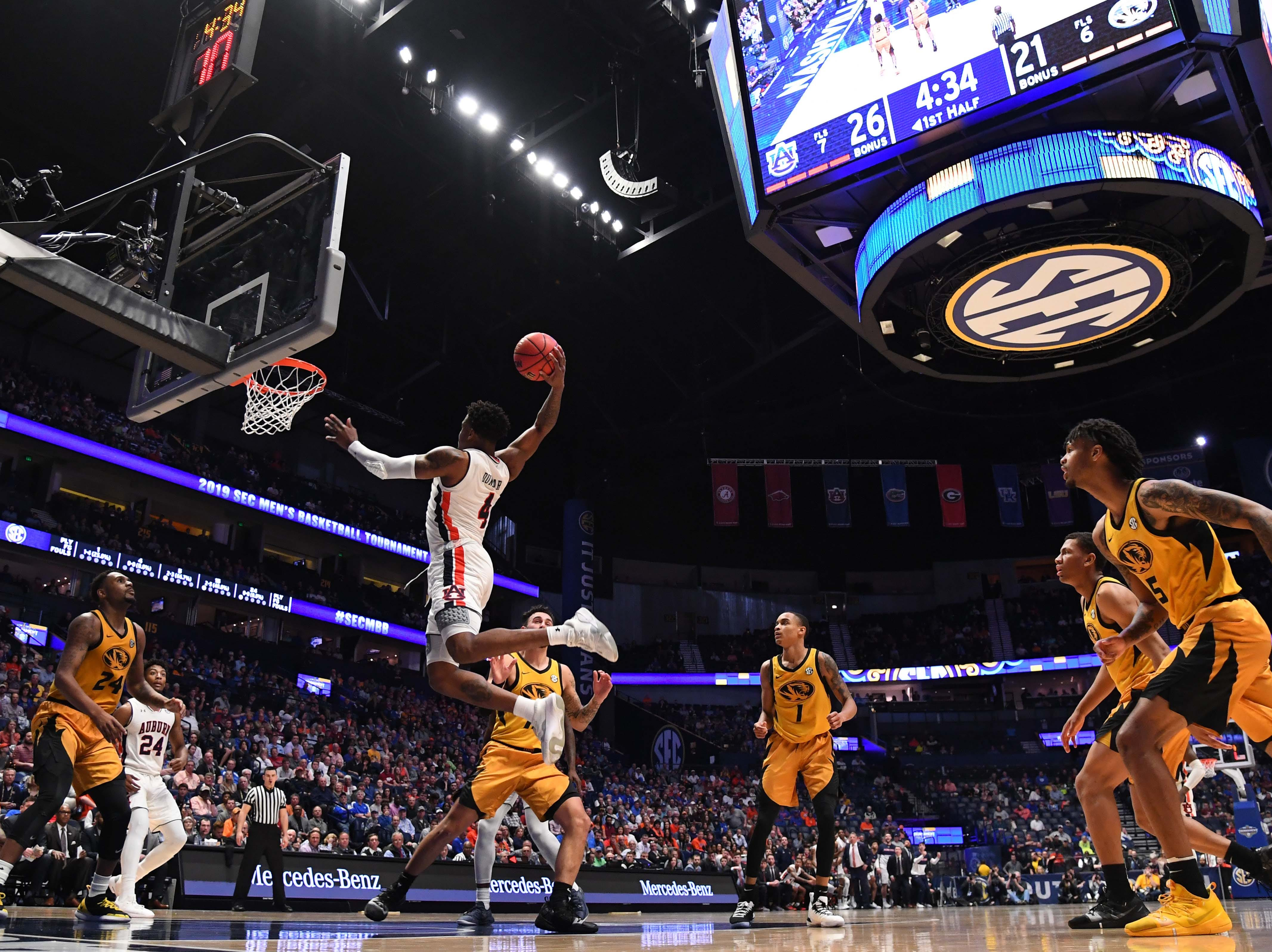 Mar 14, 2019; Nashville, TN, USA; Auburn Tigers guard Malik Dunbar (4) dunks the ball against the Missouri Tigers during the first half of the SEC conference tournament at Bridgestone Arena. Mandatory Credit: Christopher Hanewinckel-USA TODAY Sports