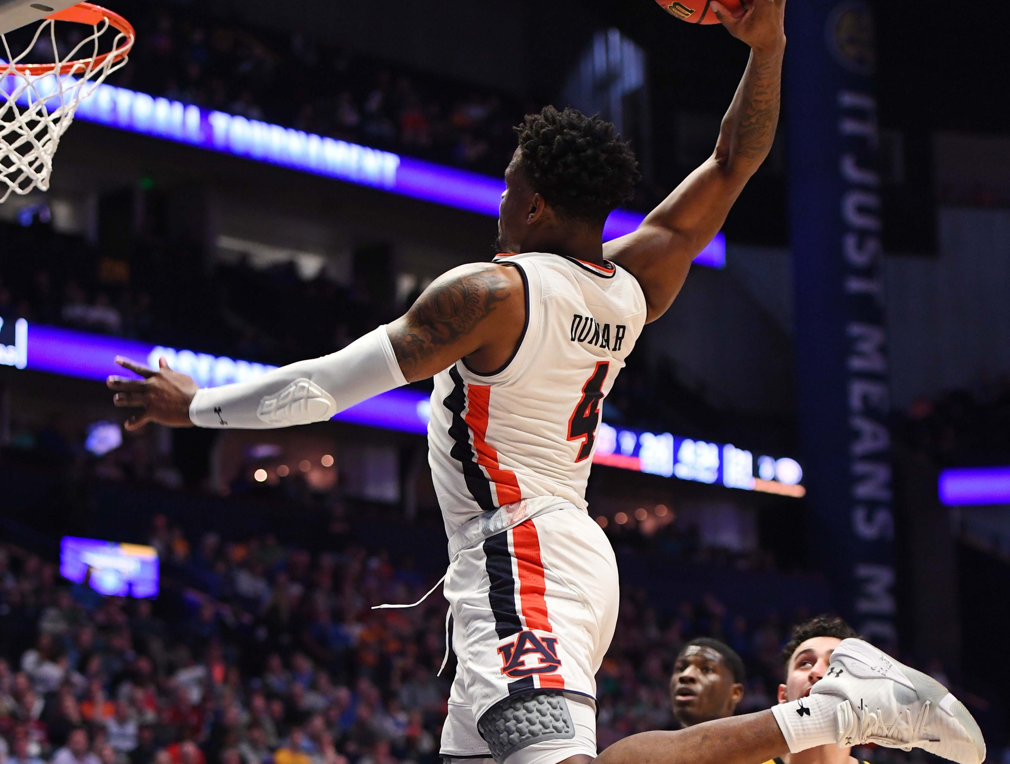 Mar 14, 2019; Nashville, TN, USA; Auburn Tigers guard Malik Dunbar (4) dunks the ball during the first half against the Missouri Tigers of the SEC conference tournament at Bridgestone Arena. Mandatory Credit: Christopher Hanewinckel-USA TODAY Sports