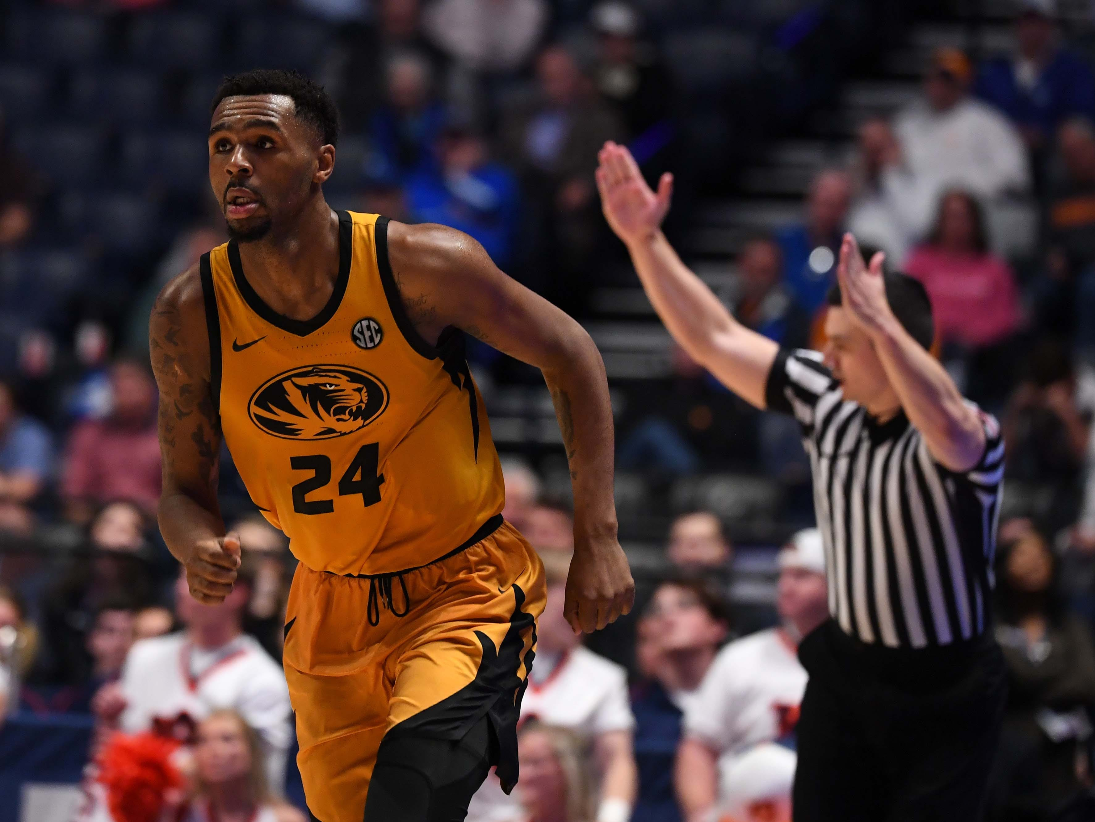 Mar 14, 2019; Nashville, TN, USA; Missouri Tigers forward Kevin Puryear (24) after making a three-pointer against the Auburn Tigers during the first half of the SEC conference tournament at Bridgestone Arena. Mandatory Credit: Christopher Hanewinckel-USA TODAY Sports