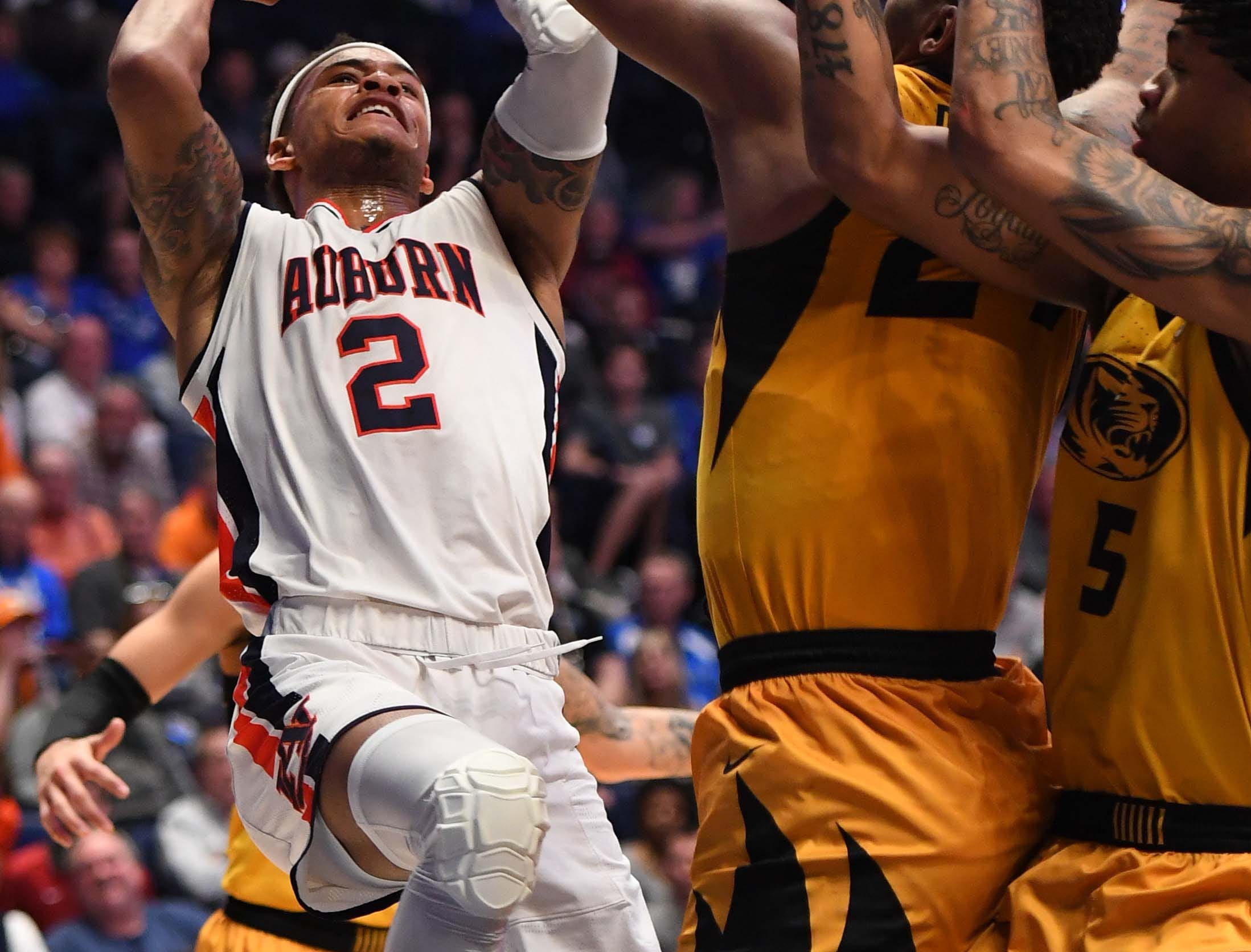 Mar 14, 2019; Nashville, TN, USA; Auburn Tigers guard Bryce Brown (2) shoots over Missouri Tigers forward Kevin Puryear (24) during the first half of the SEC conference tournament at Bridgestone Arena. Mandatory Credit: Christopher Hanewinckel-USA TODAY Sports