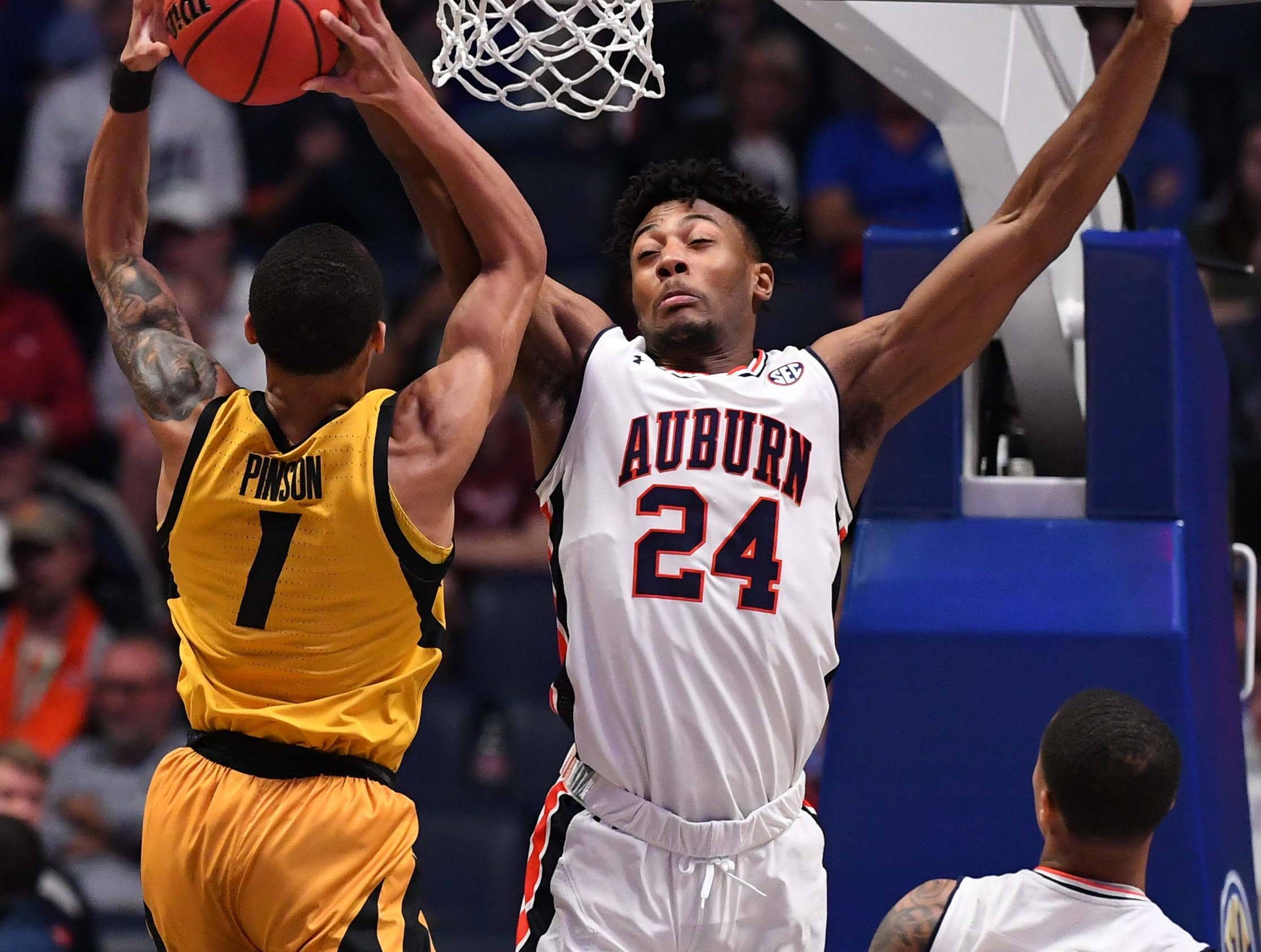 Mar 14, 2019; Nashville, TN, USA; Missouri Tigers guard Xavier Pinson (1) is fouled by Auburn Tigers forward Anfernee McLemore (24) as he attempts a shot during the first half of the SEC conference tournament at Bridgestone Arena. Mandatory Credit: Christopher Hanewinckel-USA TODAY Sports