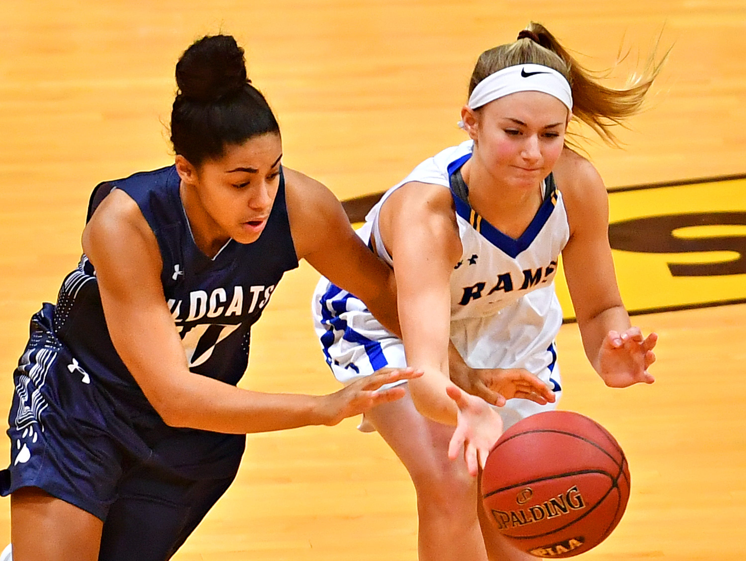 Kennard-Dale's Megan Halczuk, right, controls the ball while Mifflinburg's Angela Reamer defends during PIAA Class 4-A girl's basketball second round at Milton Hershey High School in Hershey, Wednesday, March 13, 2019. Mifflinburg would win the game 51-45. Dawn J. Sagert photo
