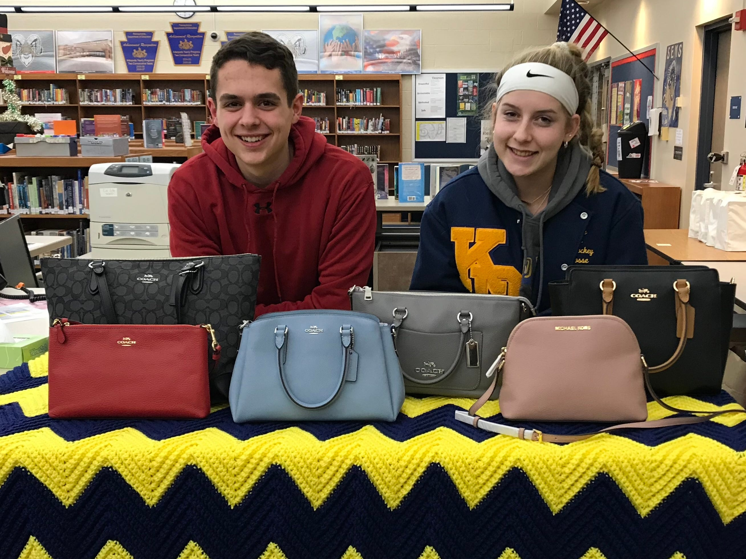 South Eastern Dollars for Scholars student reps Garrett Kilgore and Caroline Lowe pose with some of the items that can be won during theDesigner Bags and Basket Bingo benefitting South Eastern Dollars for Scholars Friday, March 22, in the Kennard-Dale High School cafeteria. The doors will open at 5:30 p.m. for food, including fried chicken dinners (until sold out), soups, sandwiches, pies, cakes, and more. Bingo will begin at 7 p.m. The evening will include 20 regular games of bingo and each winner will receive both a designer purse and a filled Longaberger basket. There will be many door prizes given away that have been donated by the community. submitted