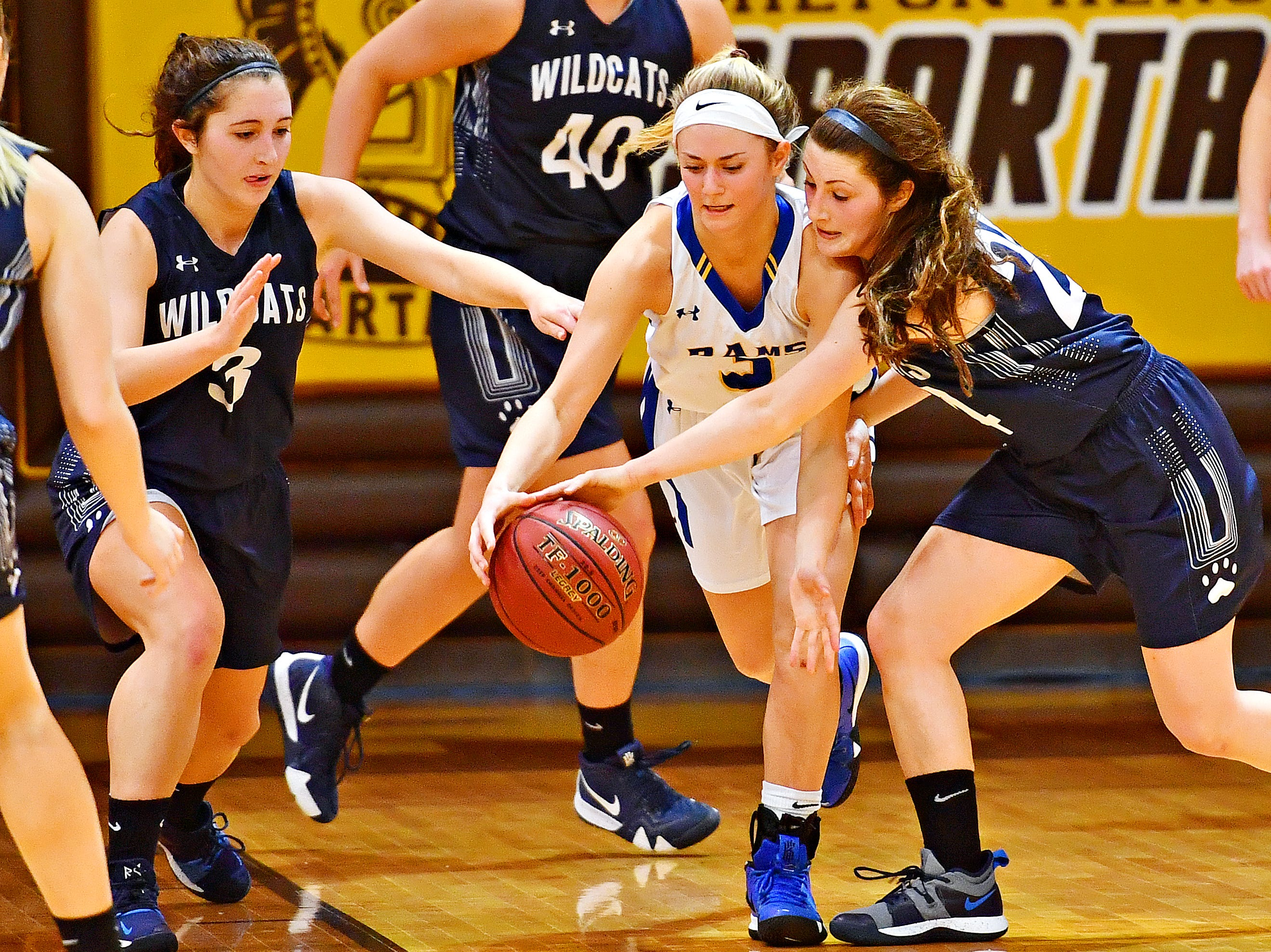 Kennard-Dale's JMegan Halczuk, left, and Mifflinburg's Reagan Griffith battle for control of a loose ball during PIAA Class 4-A girl's basketball second round at Milton Hershey High School in Hershey, Wednesday, March 13, 2019. Mifflinburg would win the game 51-45. Dawn J. Sagert photo