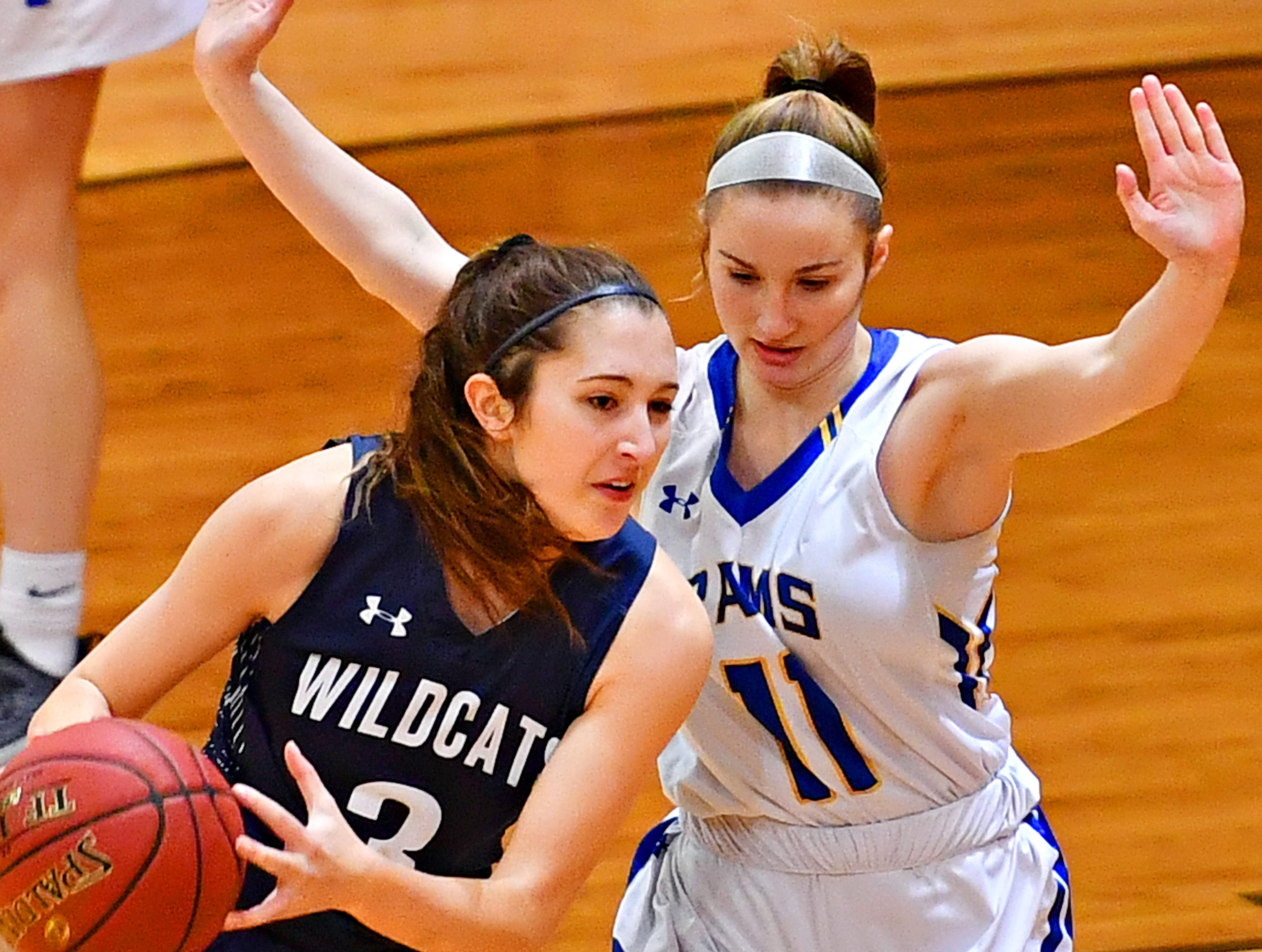 Mifflinburg's Riley Griffith, left, works to get around Kennard-Dale's Megan Thomas during PIAA Class 4-A girl's basketball second round at Milton Hershey High School in Hershey, Wednesday, March 13, 2019. Mifflinburg would win the game 51-45. Dawn J. Sagert photo