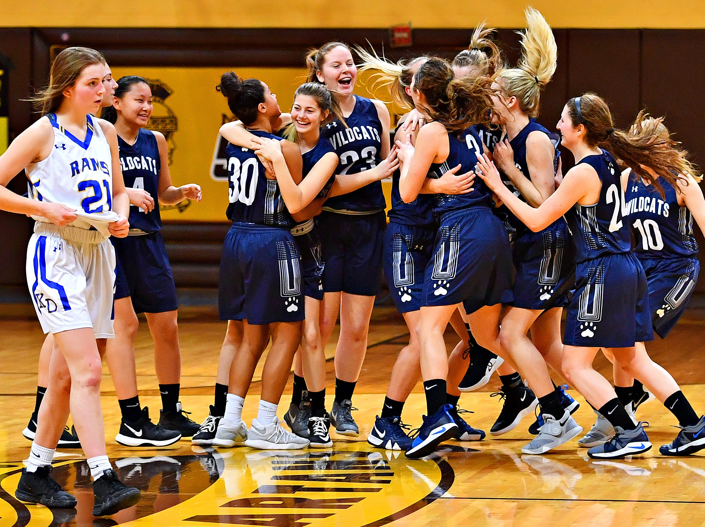 Mifflinburg celebrates a 51-45 win over Kennard-Dale during PIAA Class 4-A girl's basketball second round at Milton Hershey High School in Hershey, Wednesday, March 13, 2019. Dawn J. Sagert photo