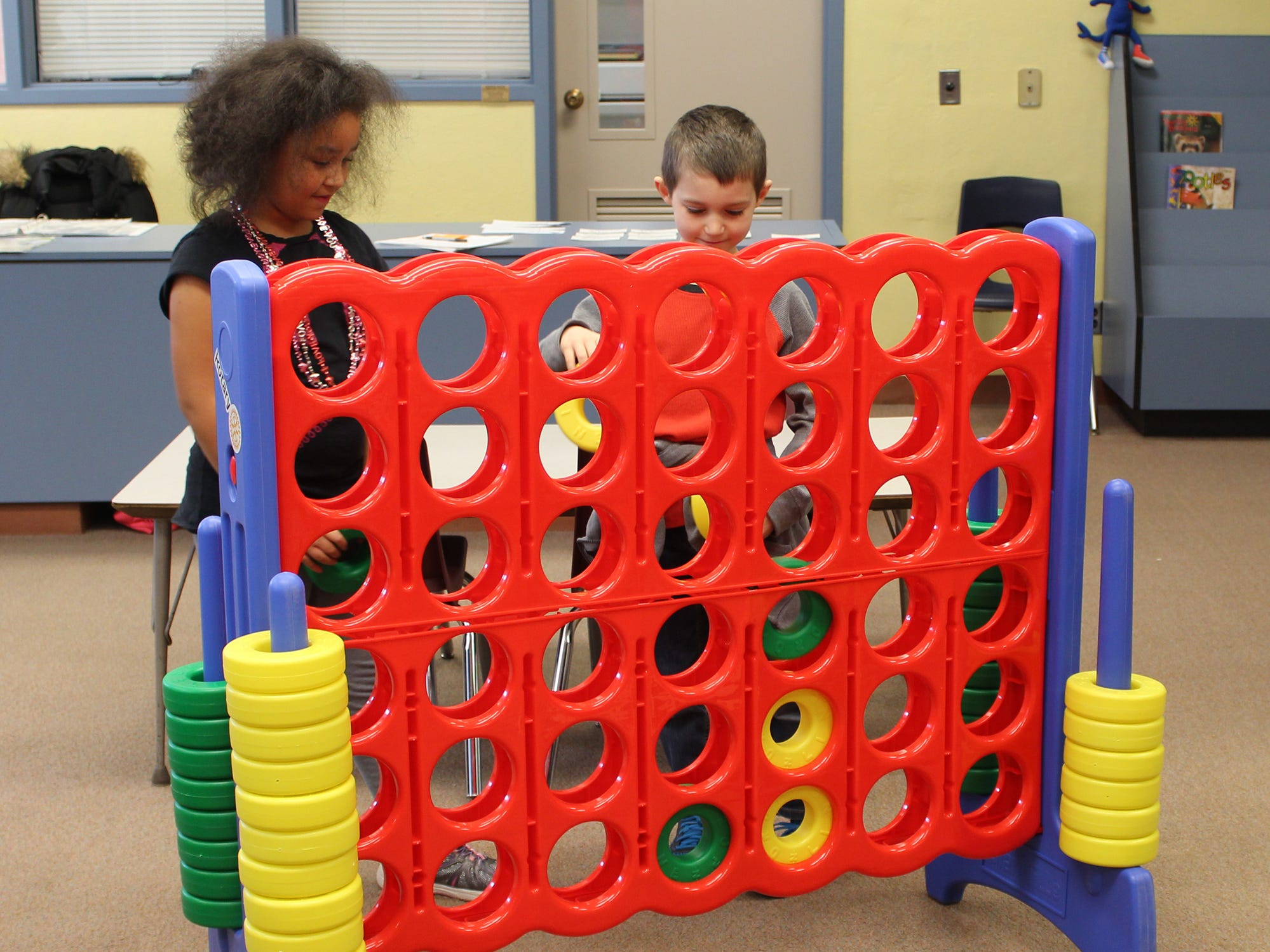 Members of the Rotary Club of Red Lion - Dallastown recently delivered and assembled several pieces of play equipment to the students of the Windsor Manor Elementary School in the Red Lion Area School District. Students Jelena Jones (left) and Dakota Pipher try out the Connect 4 game. The club used club-generated funds from various fundraising activities and funds from a Rotary District Grant to purchase the items. submitted