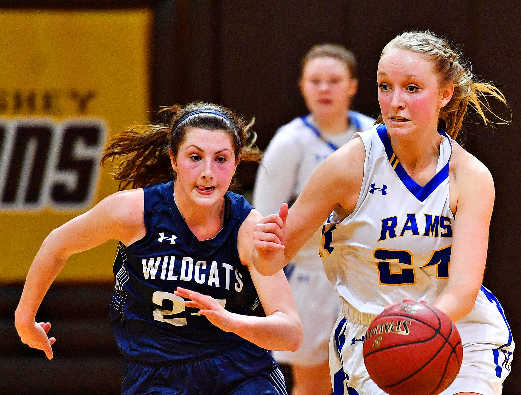 Kennard-Dale's Lexie Kopko, right, advances the ball while Mifflinburg's Reagan Griffith defends during PIAA Class 4-A girl's basketball second round at Milton Hershey High School in Hershey, Wednesday, March 13, 2019. Mifflinburg would win the game 51-45. Dawn J. Sagert photo