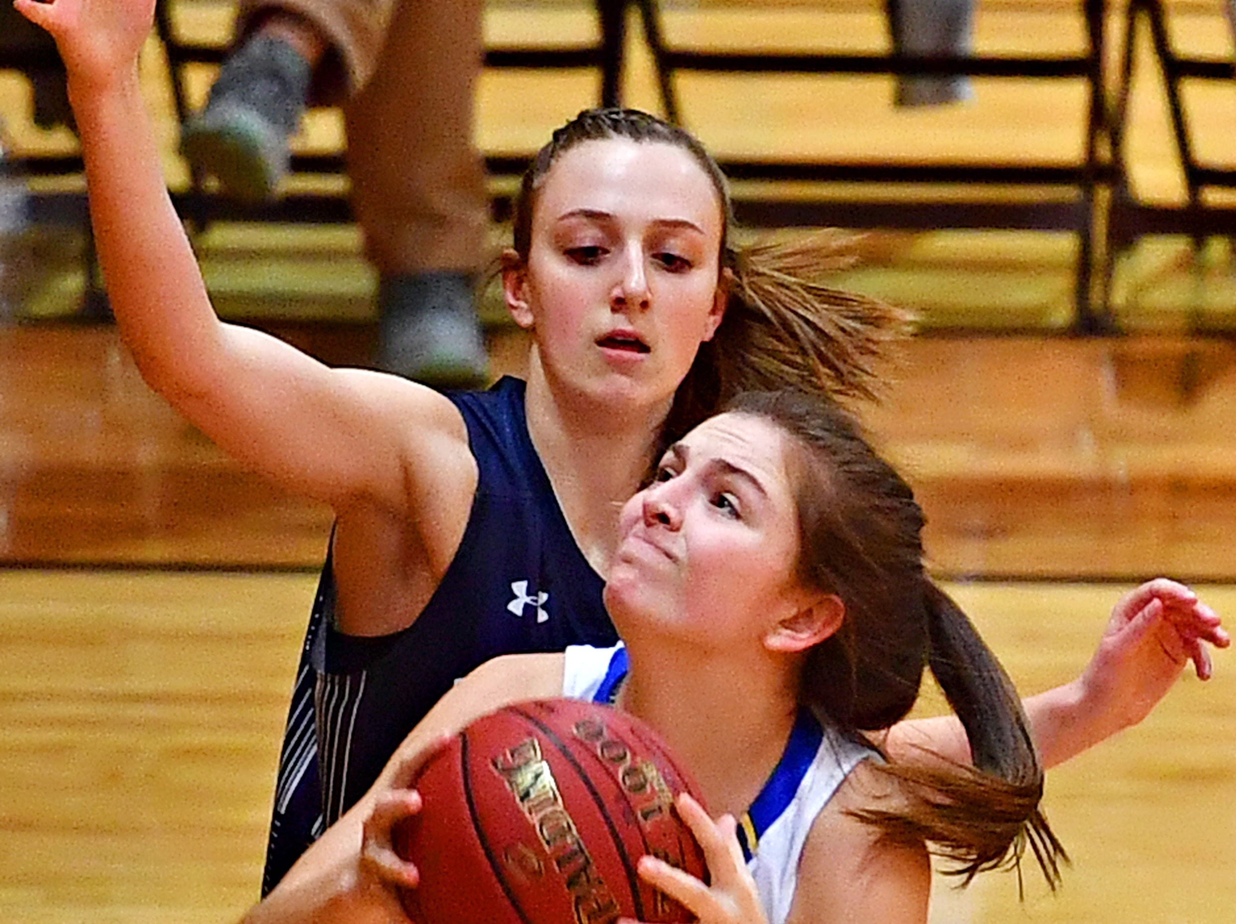 Kennard-Dale's Jaedyn McKeon, front, takes the ball to the basket while Mifflinburg's Mollie Bomgardner defends during PIAA Class 4-A girl's basketball second round at Milton Hershey High School in Hershey, Wednesday, March 13, 2019. Mifflinburg would win the game 51-45. Dawn J. Sagert photo