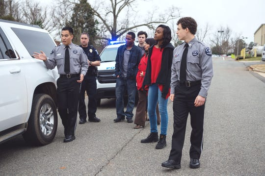 Young people and police officers interact as part of Boy Scouts of America's Explorers Program.