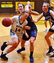 Kennard-Dale's Chandler Swanson, left, works to get around Mifflinburg's Riley Griffith during PIAA Class 4-A girl's basketball second round at Milton Hershey High School in Hershey, Wednesday, March 13, 2019. Mifflinburg would win the game 51-45. Dawn J. Sagert photo