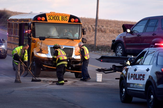 Dallastown Area High School students escaped injury when a car slammed head on into their bus on Cape Horn Road, Thursday, March 13, 2019.John A. Pavoncello photo