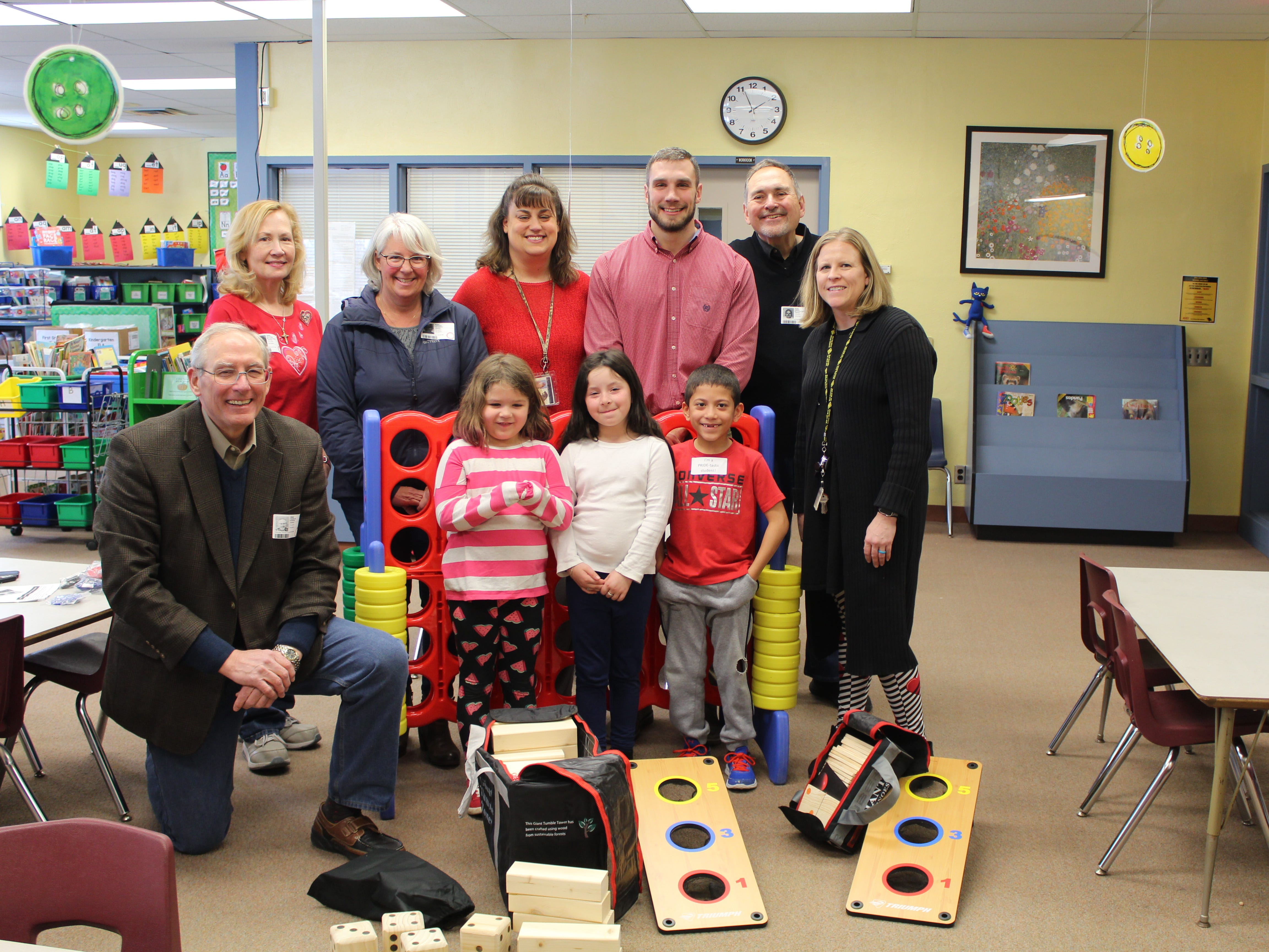 Members of the Rotary Club of Red Lion - Dallastown recently delivered and assembled several pieces of play equipment to the students of the Windsor Manor Elementary School in the Red Lion Area School District. The club used club-generated funds from various fundraising activities and funds from a Rotary District Grant to purchase the items. Club members along with students and school staff look over all the donated items. From left to right are: Club President, Frank Herron; Club members Del McChalicher and Lori Polakoff, Windsor Manor Teachers Julie Brunetto and Levi Myers, Club member Kim McChalicher, and WIndsor Manor Principal Sheila Hughes. Students from left to right are: Christy Whitcraft, Alaina Guzman, and J'Maani Markline. submitted