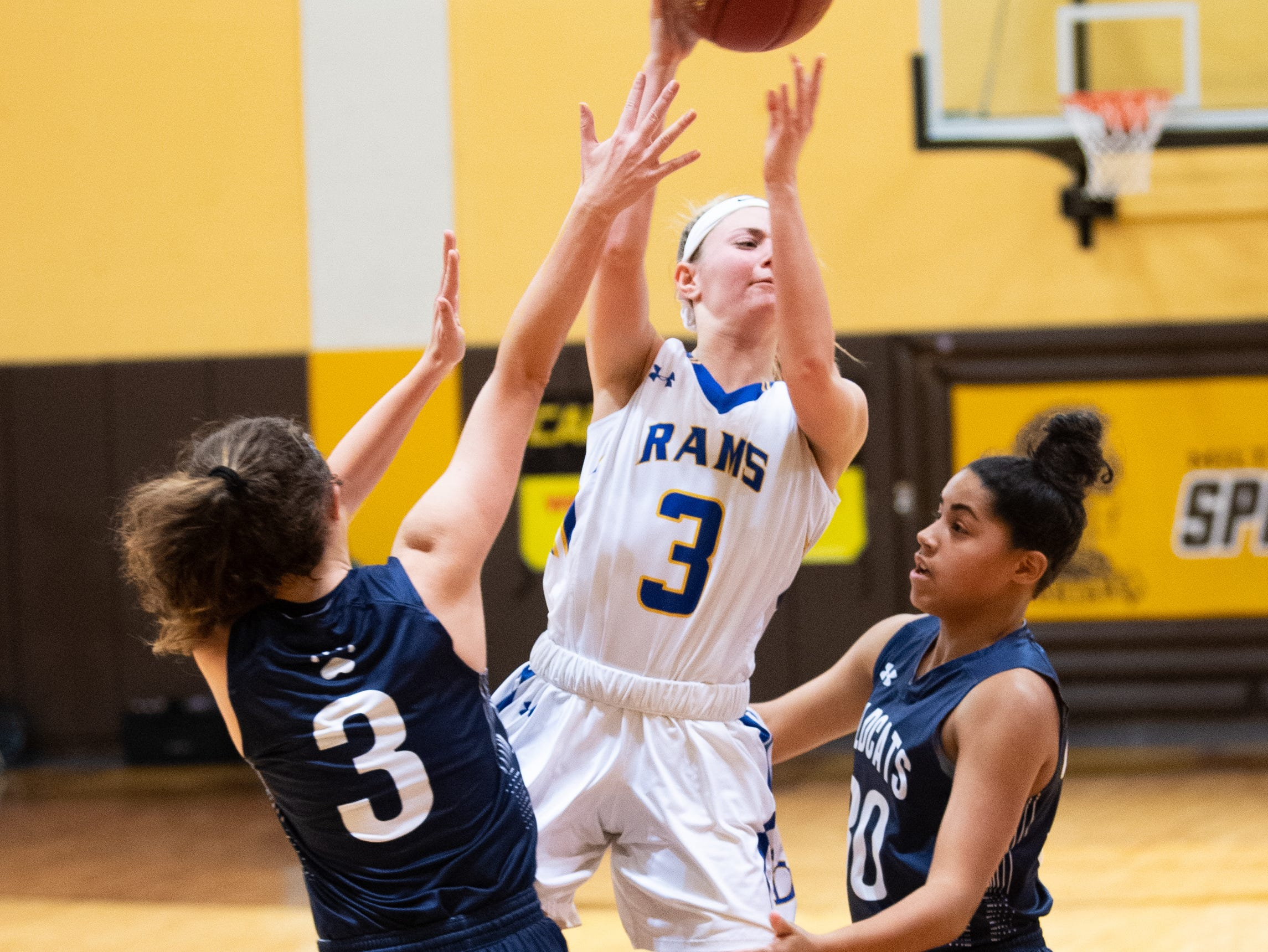 Megan Halczuk (3) passed the ball out of danger during the PIAA second round girls' basketball game between Kennard-Dale and Mifflinburg Area, March 13, 2019 at Milton Hershey School. The Rams fell to the Wildcats 51 to 45.