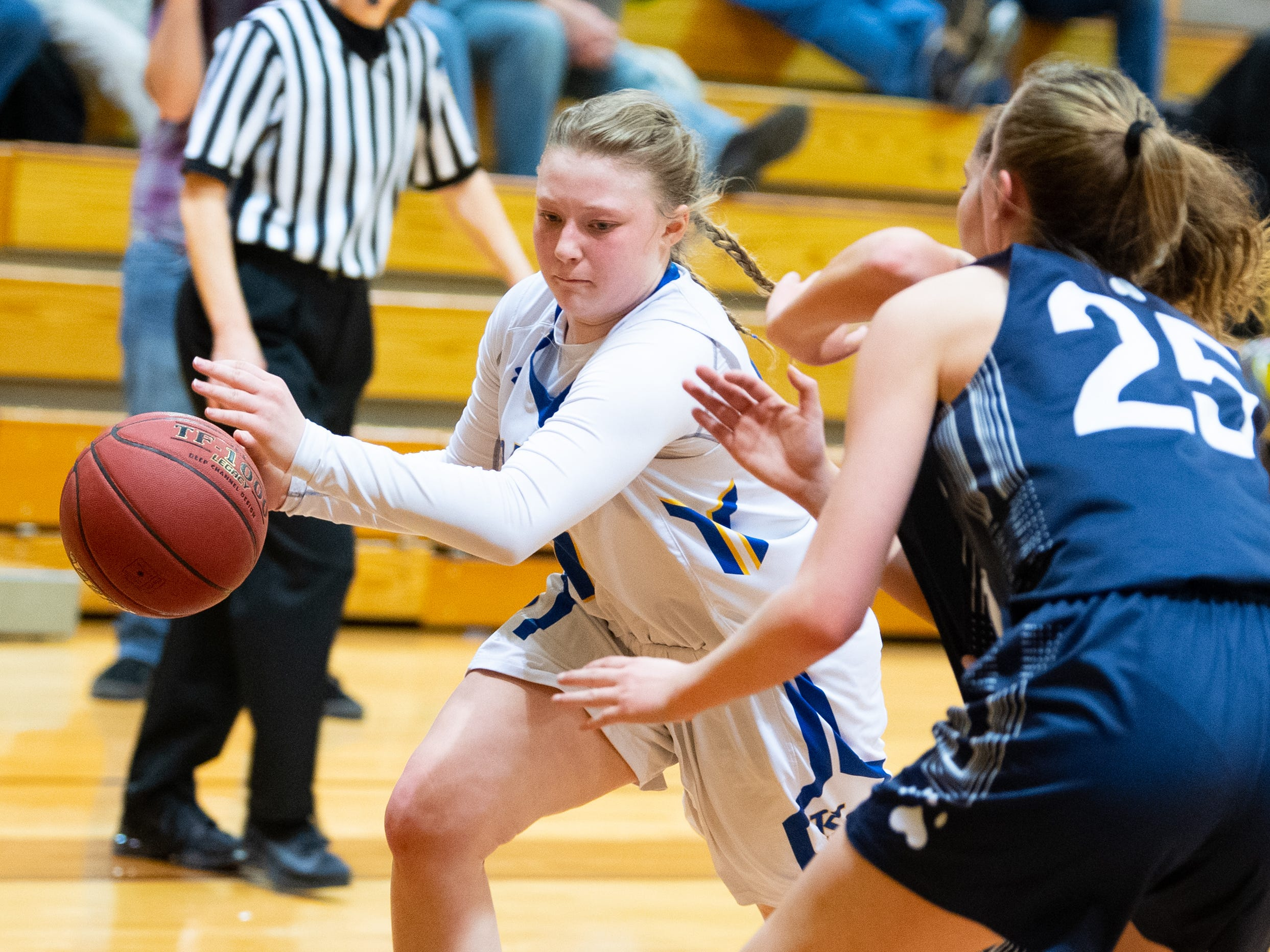 Chandler Swanson (14) looks to go past the defense during the PIAA second round girls' basketball game between Kennard-Dale and Mifflinburg Area, March 13, 2019 at Milton Hershey School. The Rams fell to the Wildcats 51 to 45.