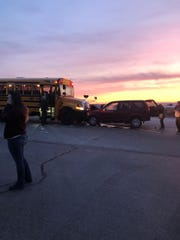 A bystander to a car versus bus crash snapped a shot of the incident as the sun was coming up.